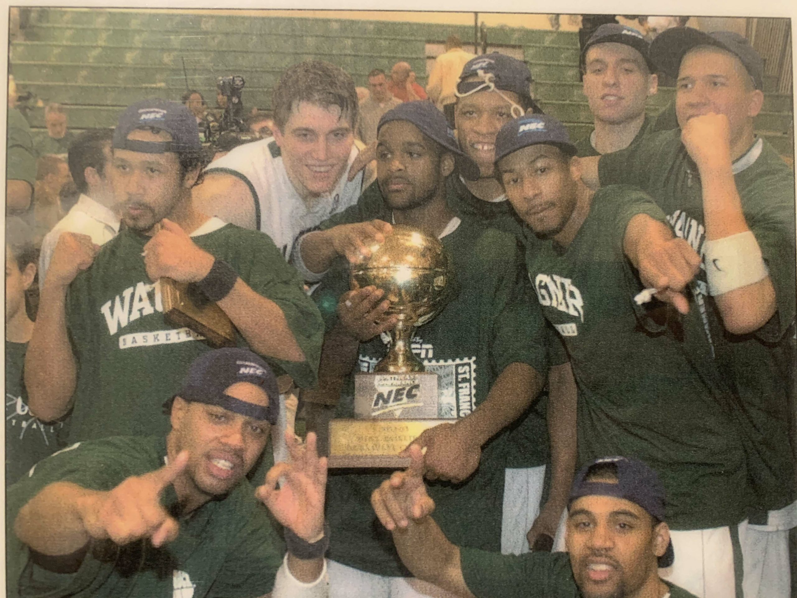 Courtney Pritchard ,center, holding trophy with his Wagner College teammates after winning the NEC title, which catapulted the team to the NCAA tournament in his junior year.