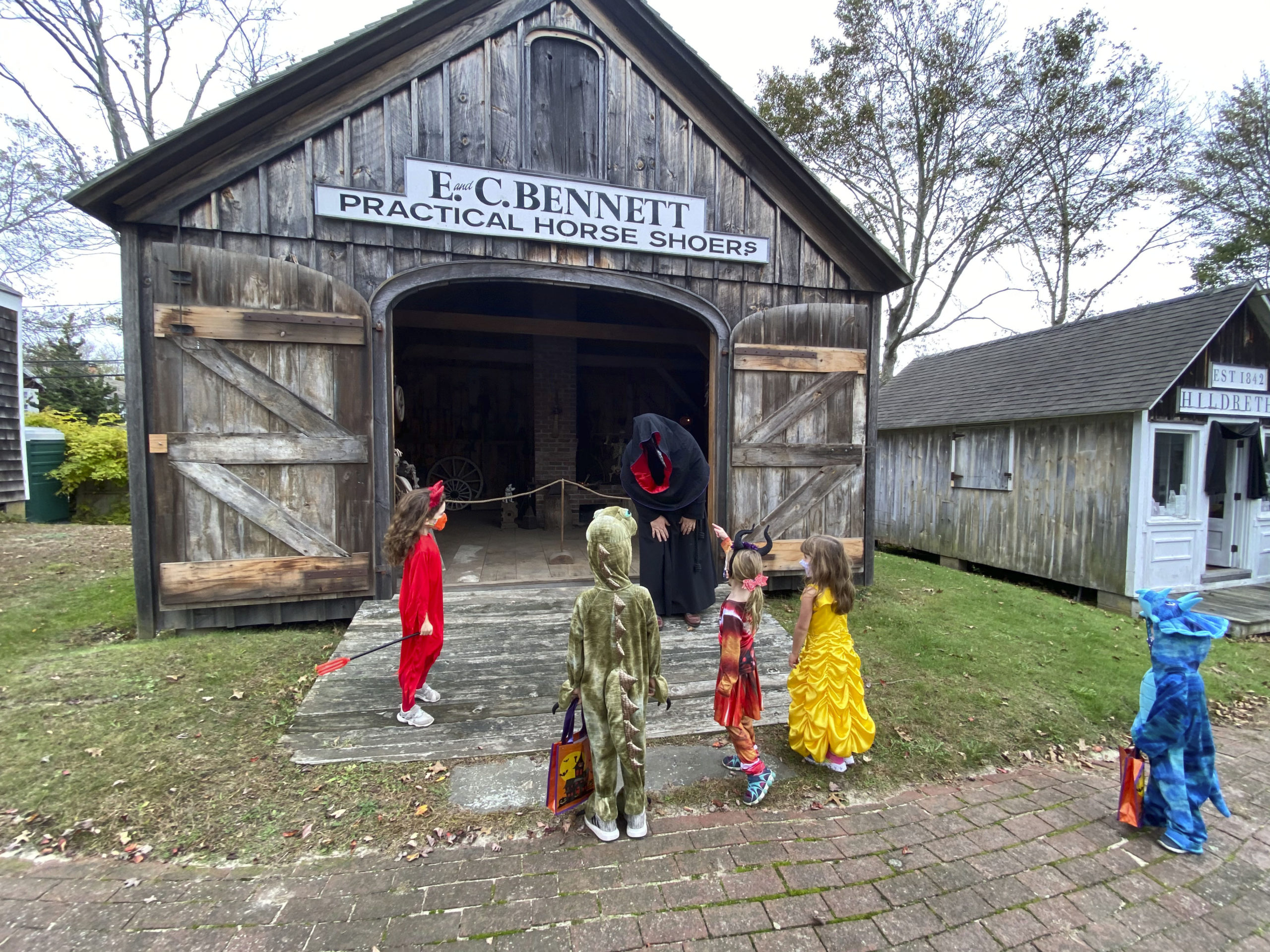 Children visit the Haunted Village at the Southampton History Museum on Saturday. The grounds of the Rogers Mansion are decorated for Halloween and are inhabited by witches, ghouls and even a plague doctor. The Haunted Village will be opened on Saturday October 31 from 2 to 4 p.m. Visitors are encouraged to wear their costumes. Reservations required with timed entrances for a 20 minute tour. Limited to 100 people at one time, only family groups of up to 6 allowed per reservation. Children must be accompanied by an adult with a reservation. Facemasks required and social distancing strictly enforced. Call (631) 283-2494 or visit southamptonhistory.org for more information. DANA SHAW