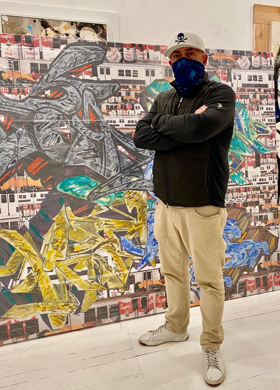 """Mike Namer in front of Fab 5 Freddy's """"Metro Movement"""" 2011."""