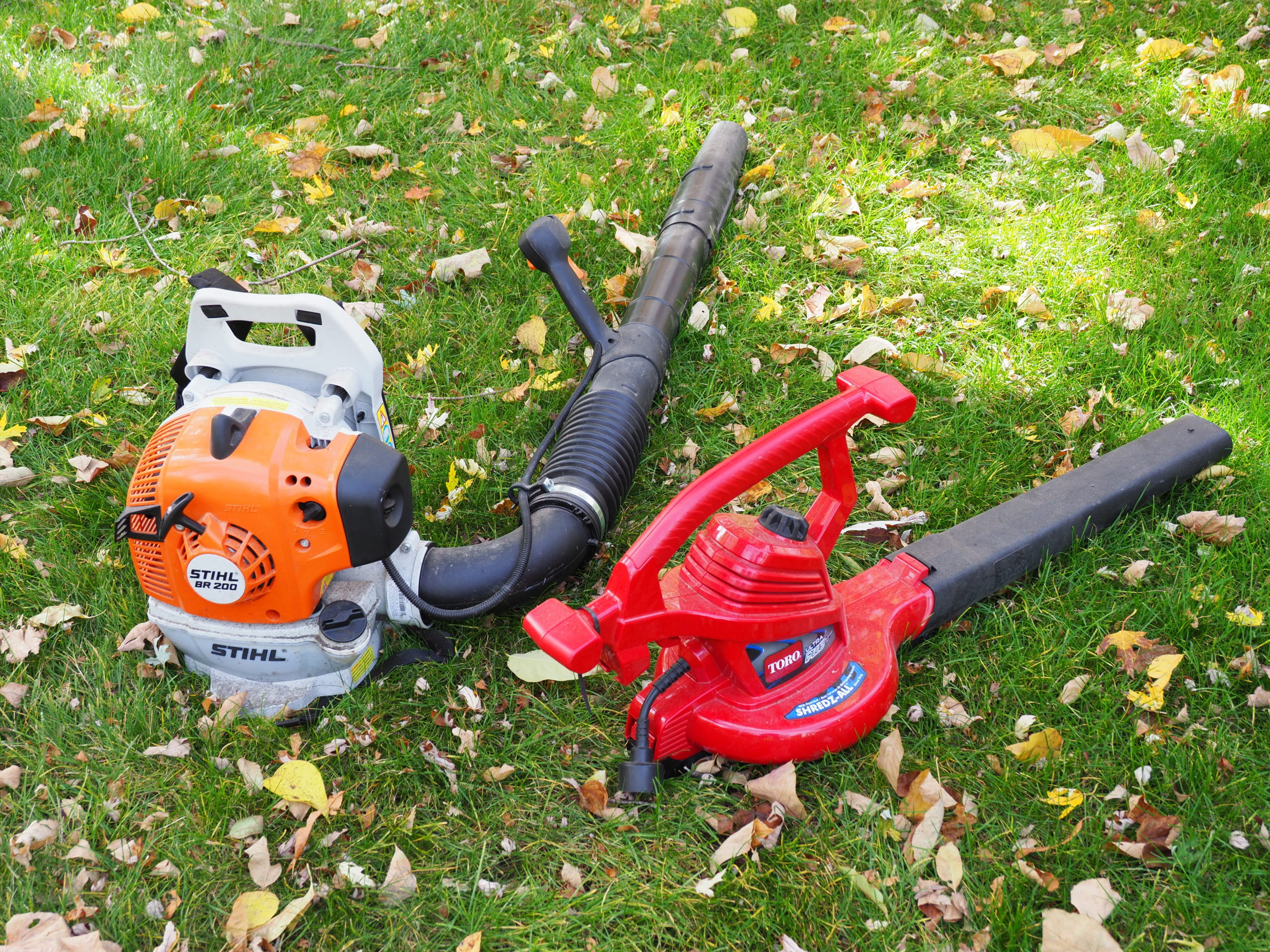 On the left, a small and lightweight 2-cycle leaf blower. The one on the right is a corded electric blower/shredder that cost less than a third of the gas blower, blows nearly as well but unlike the gas one the electric can shred the leaves it collects and it weighs 40 percent less. However, it's only good for about 100 feet from your electric outlet.