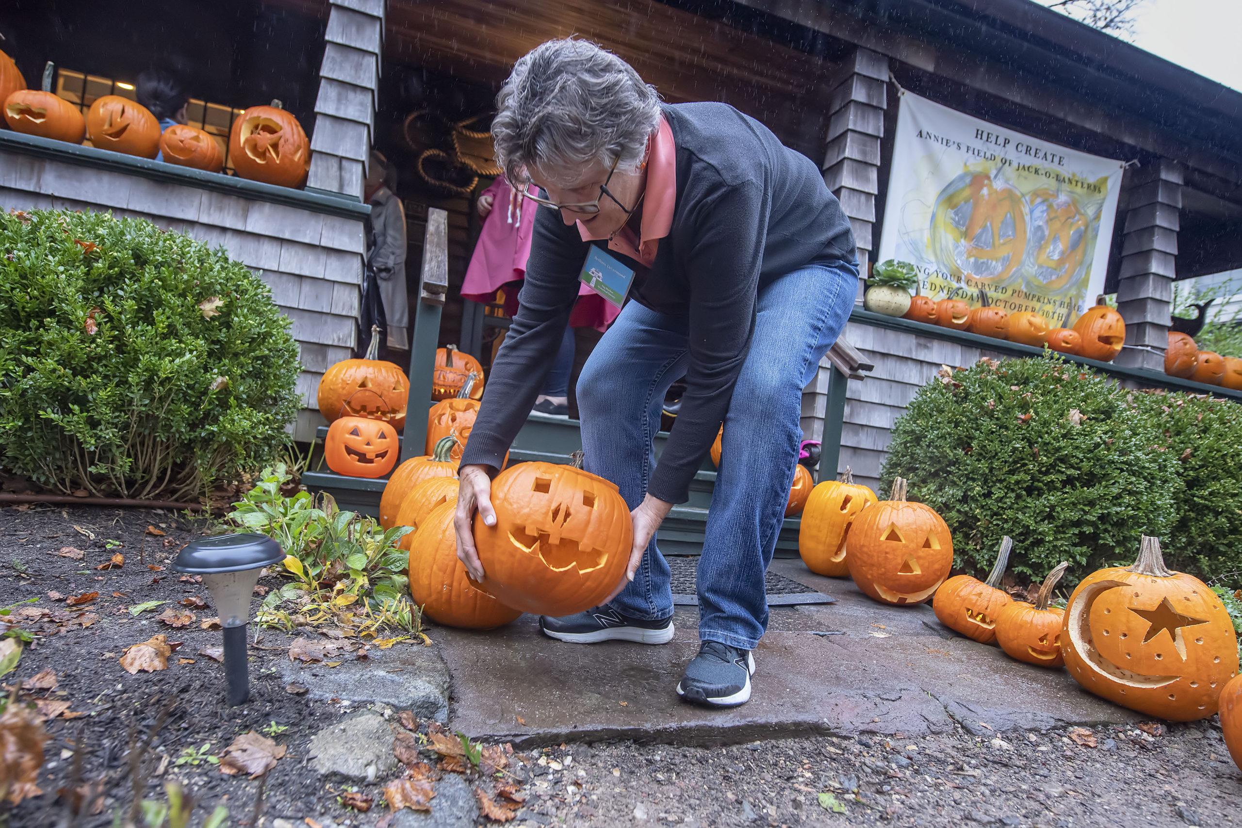 Sag Harbor Historical Society board member Bethany Deyermond arranges pumpkins at last year's