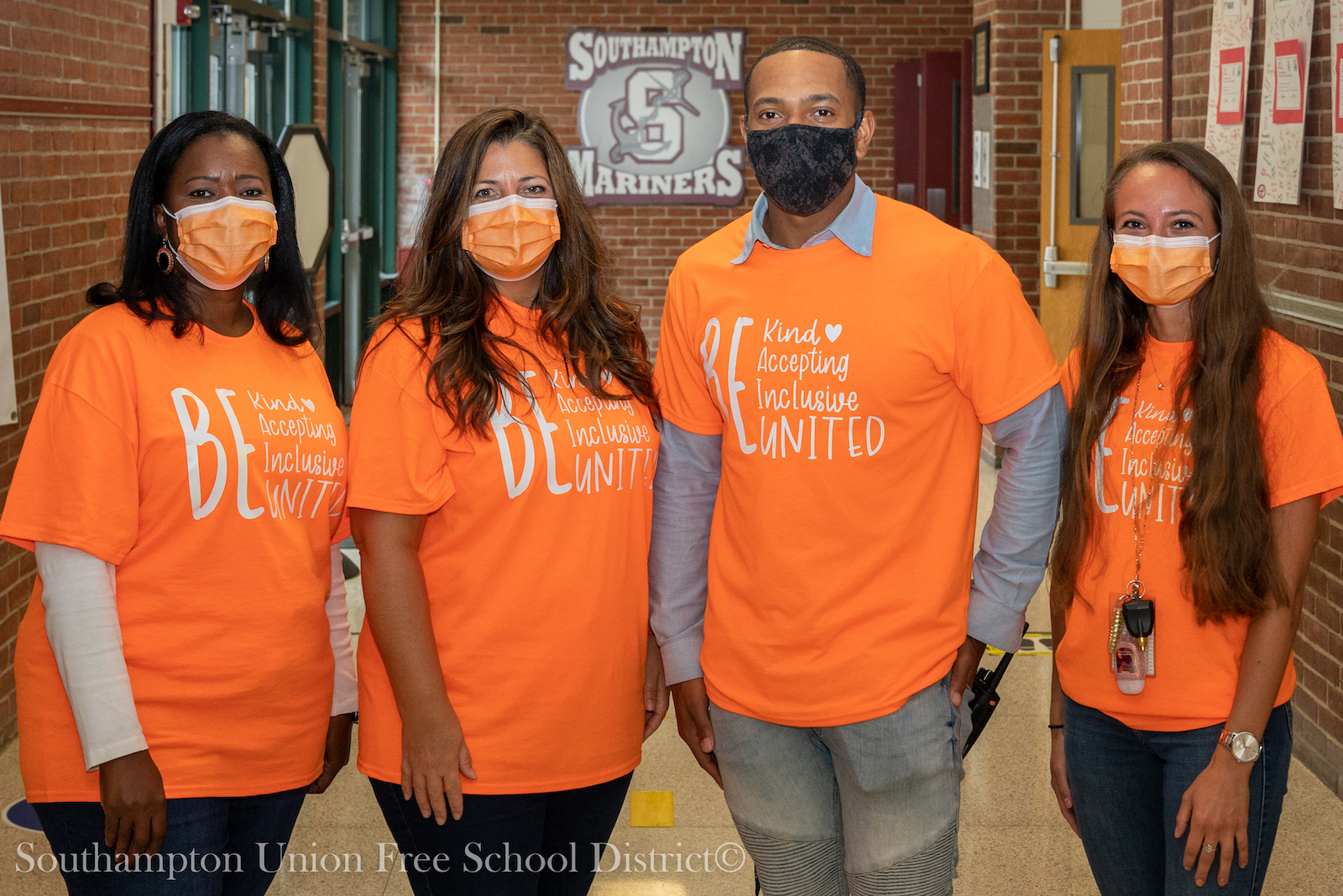 """Southampton Intermediate School marked Unity Day on October 21, as well as the day following, with staff and students wearing orange shirts and masks. The two-day event, spearheaded by the guidance department, also encouraged everyone to write something positive about themselves on a paper strip that would be included in a """"chain of unity"""" displayed in the school's lobby."""
