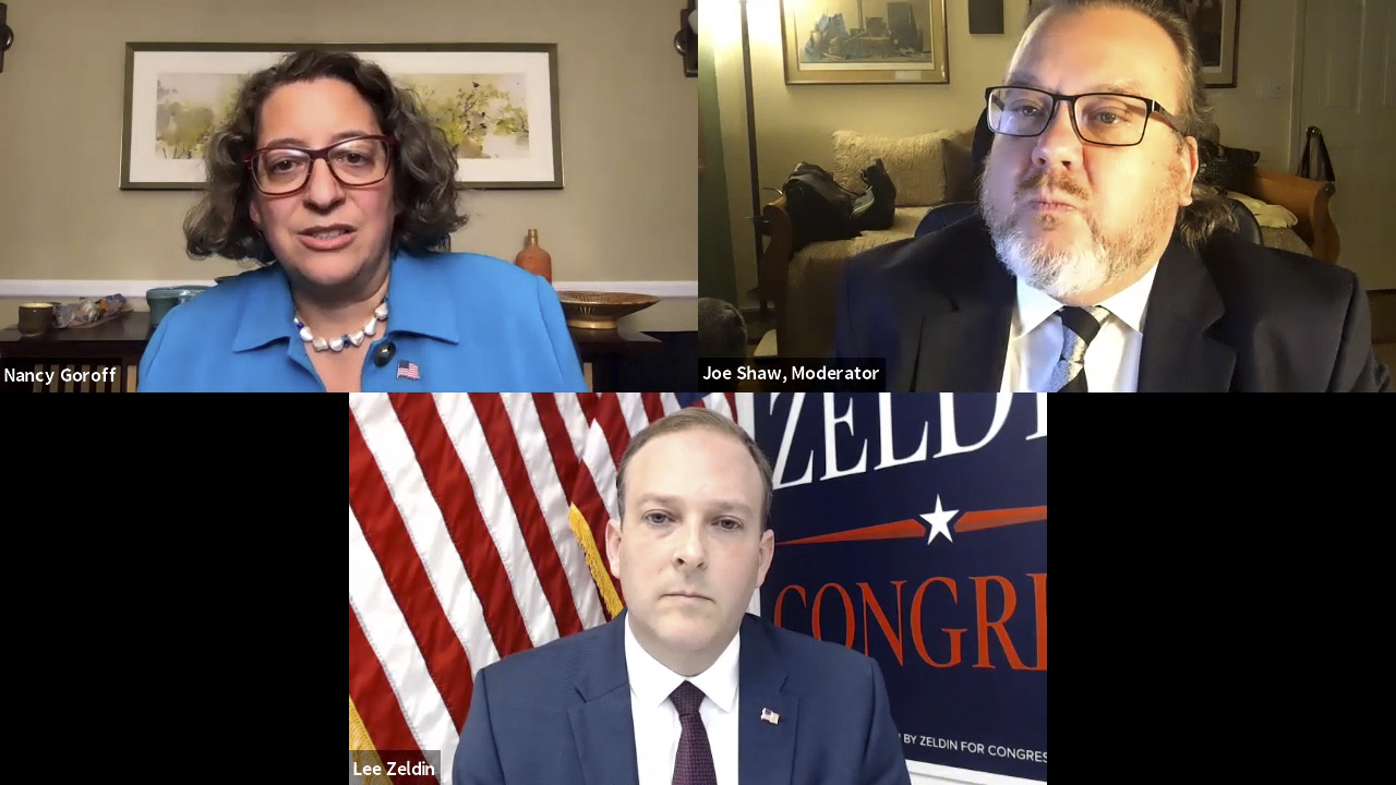 Candidates Nancy Goroff and Lee Zeldin with Express News Group Executive Editor Joe Shaw during Monday night's debate.