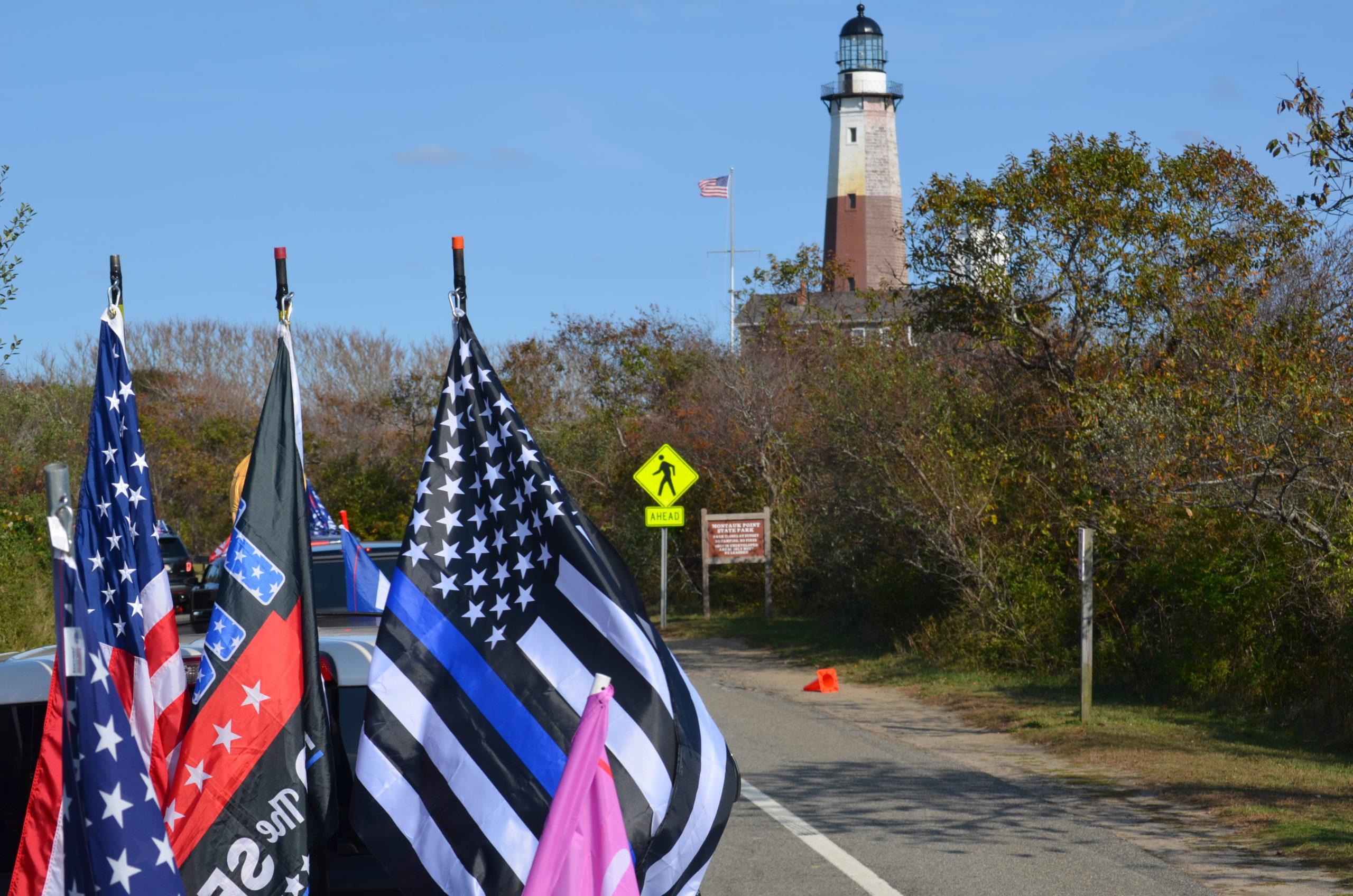 The parade passes the Montauk Lighthouse on October 18.