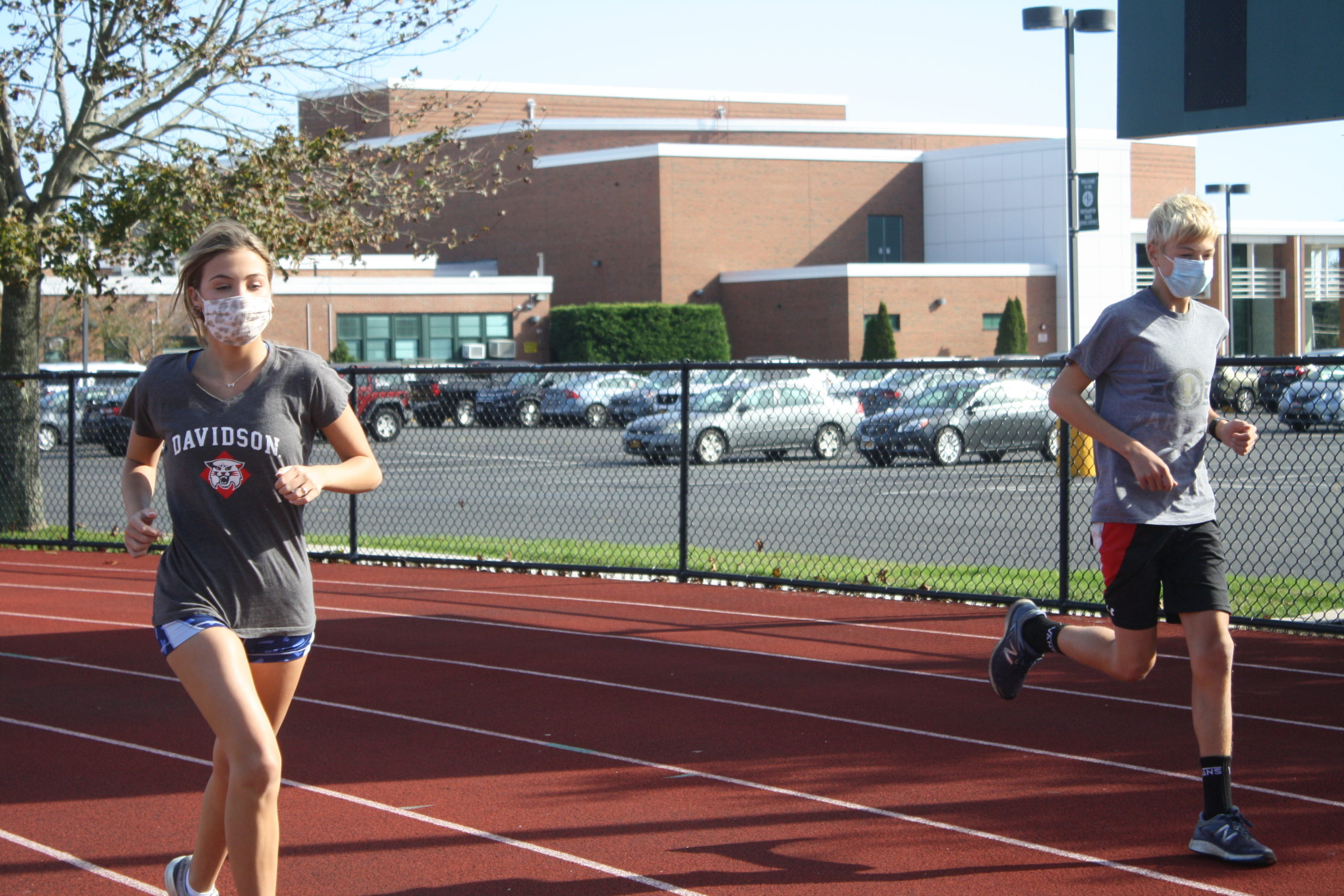 Westhampton Beach juniors Katie Ryan and Cole Cammarata at intramural track practice last week.  CAILIN RILEY