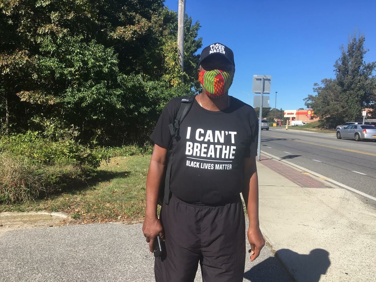 In East Patchogue on Thursday, Leon Goodman is walking 118 miles, from Manhattan to Montauk to protest acts of police brutality. KITTY MERRILL