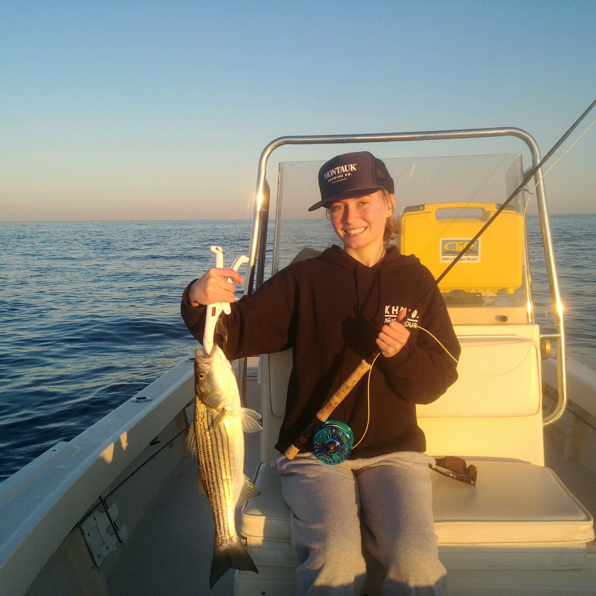 Huge schools of striped bass, like this one caught on fly by Lily Richter, continue to boil the surface of the sea off Montauk.