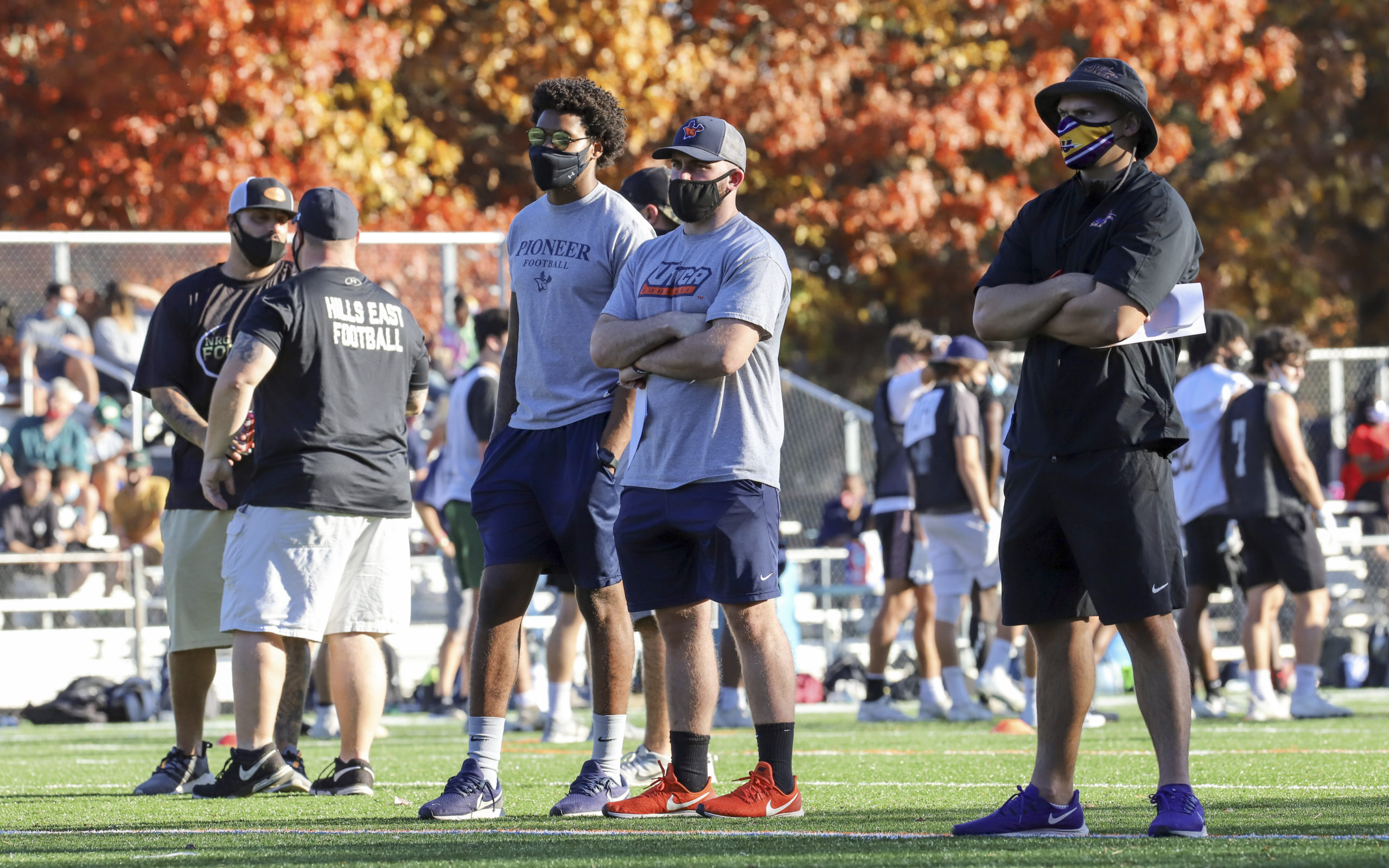 Utica College coaches Nick Woodman, the assistant coach, and Antonio Scala, the assistant coach of linebackers, and Alfred University special teams coordinator and defensive backs coach Holden Whitehead scout players during the Suffolk County Football Coaches Association's seventh annual showcase November 8.   CHRISTINE HEEREN