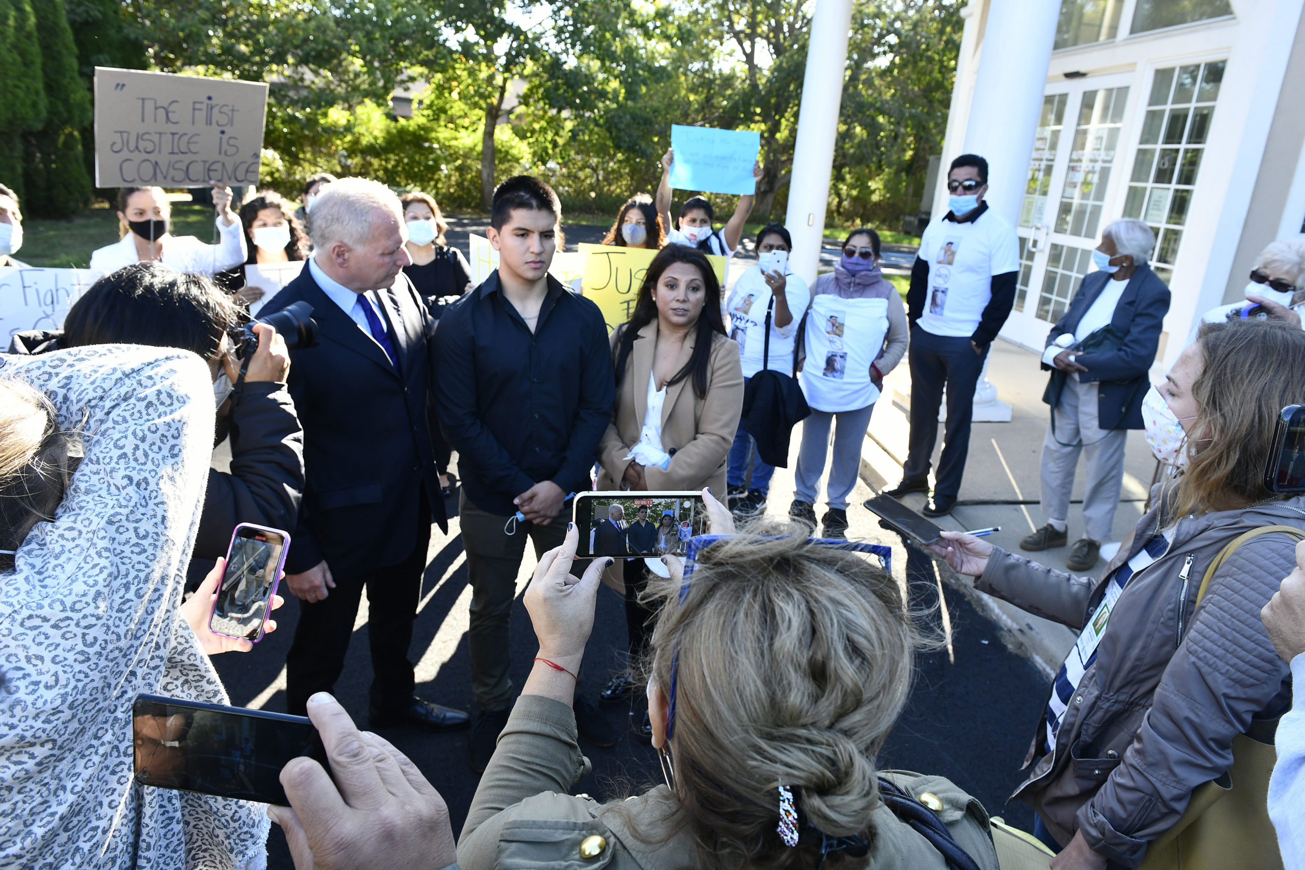 Attorney Edmond C. Chakmakian, David Peralta-Mera and his mother, Jenny outside of East Hampton Town justice Court in October.  DANA SHAW