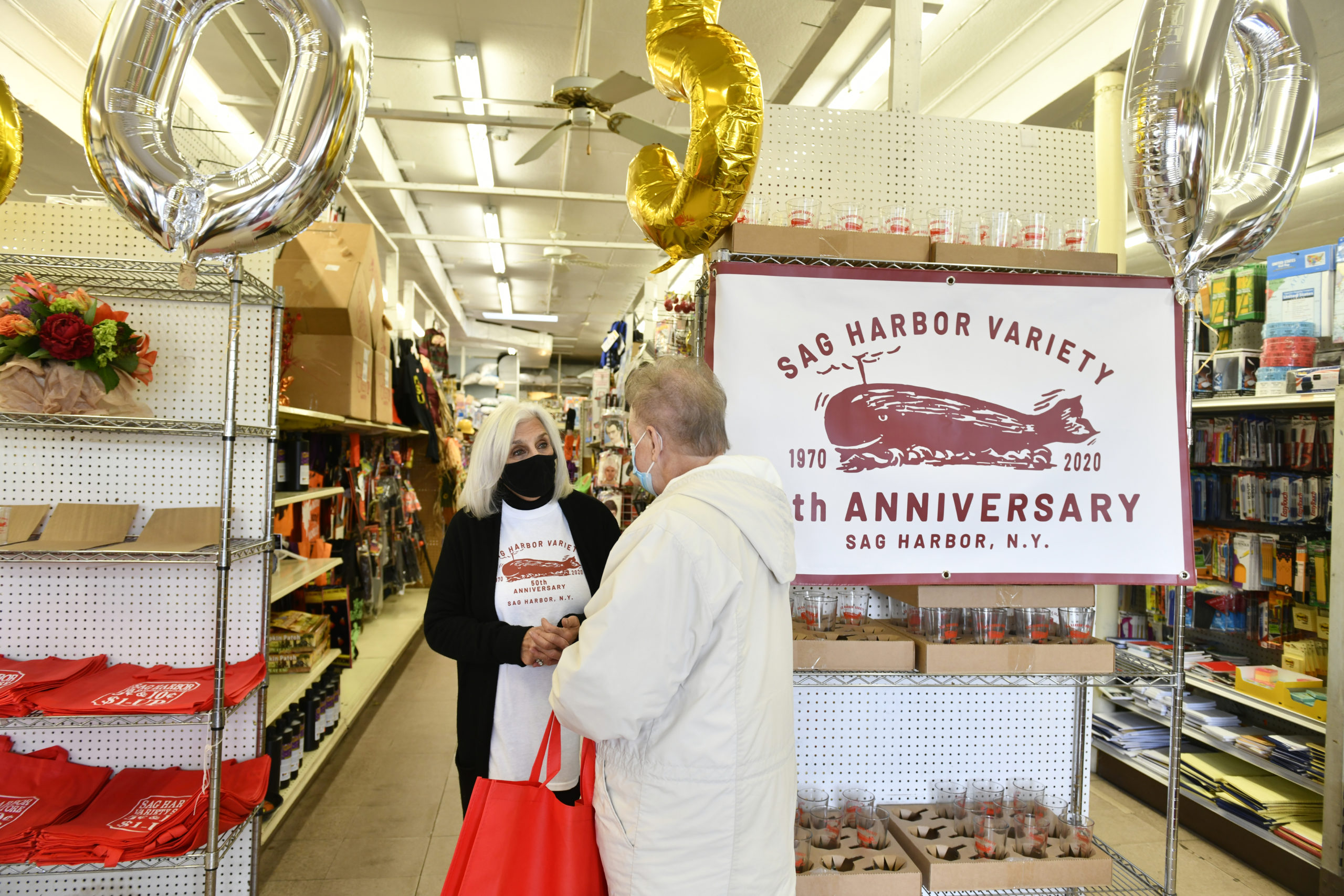 Roseann Bucking chats with a customer on Saturday at the Sag Harbor Variety Store's 50th anniversary celebration.  DANA SHAW