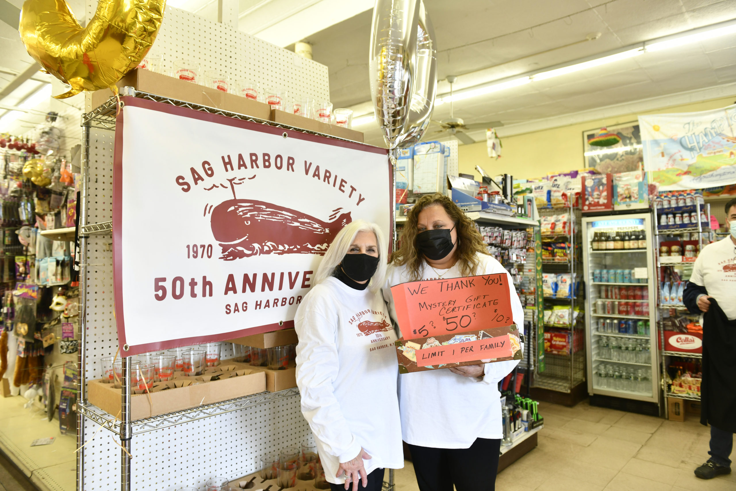Roseann Bucking and Lisa Field greet customers on Saturday at the Sag Harbor Variety Store's 50th anniversary celebration.    DANA SHAW