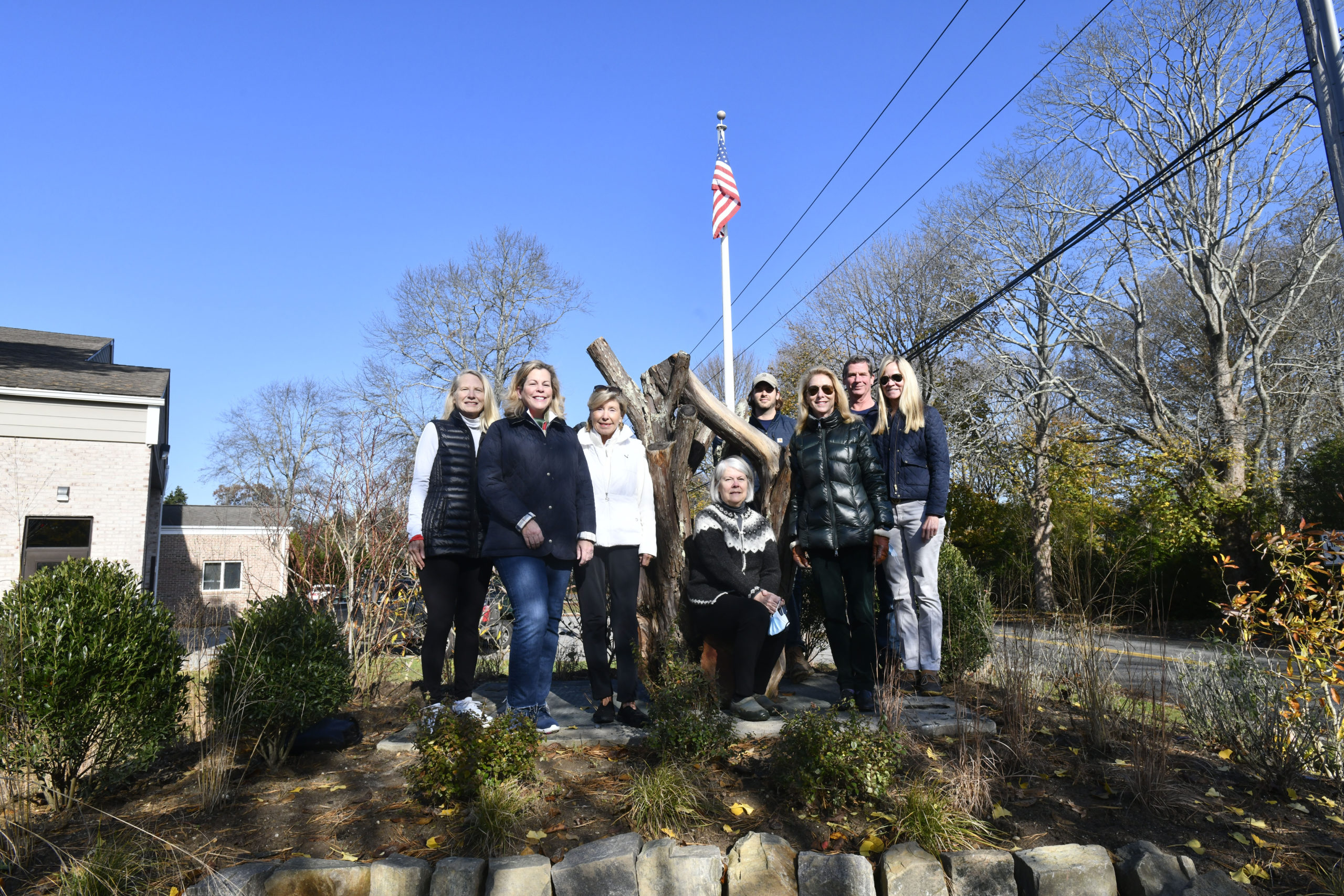 The Southampton Garden Club, along with Jacob Antilety Landscaping, recently revamped the Liberty Garden located at the Southampton Fire Station on the corner of Montauk Highway and St. Andrews Road. The Liberty Garden was created after the September 11, 2001 attacks. The garden now boasts native plants, pollinators and a sculpted yew tree stump. In the garden, left to right are, Helene Fagan Barbara Glatt, Christl Meszkat, Lydia Wallis, Alex Antilety, Sacha MacNaughton, Mark Antilety and Deborah De La Gueronniere.     DANA SHAW