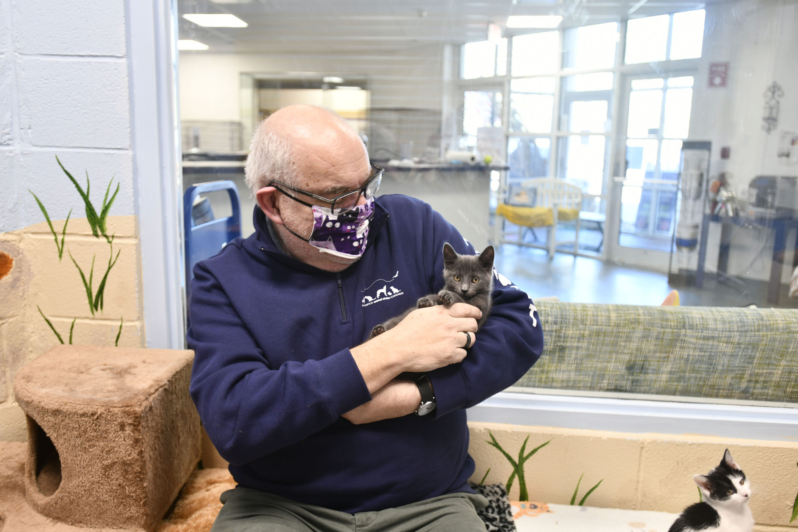 Joe Sprague with one of his charges at the Southampton Animal Shelter.  DANA SHAW