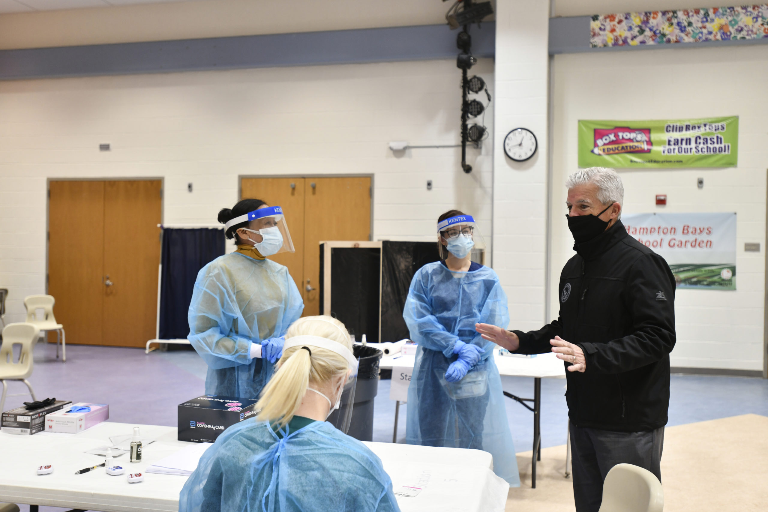 Suffolk County Executive Steve Bellone visited Hampton Bays Middle School on Thursday to check out the testing facility.   DANA SHAW
