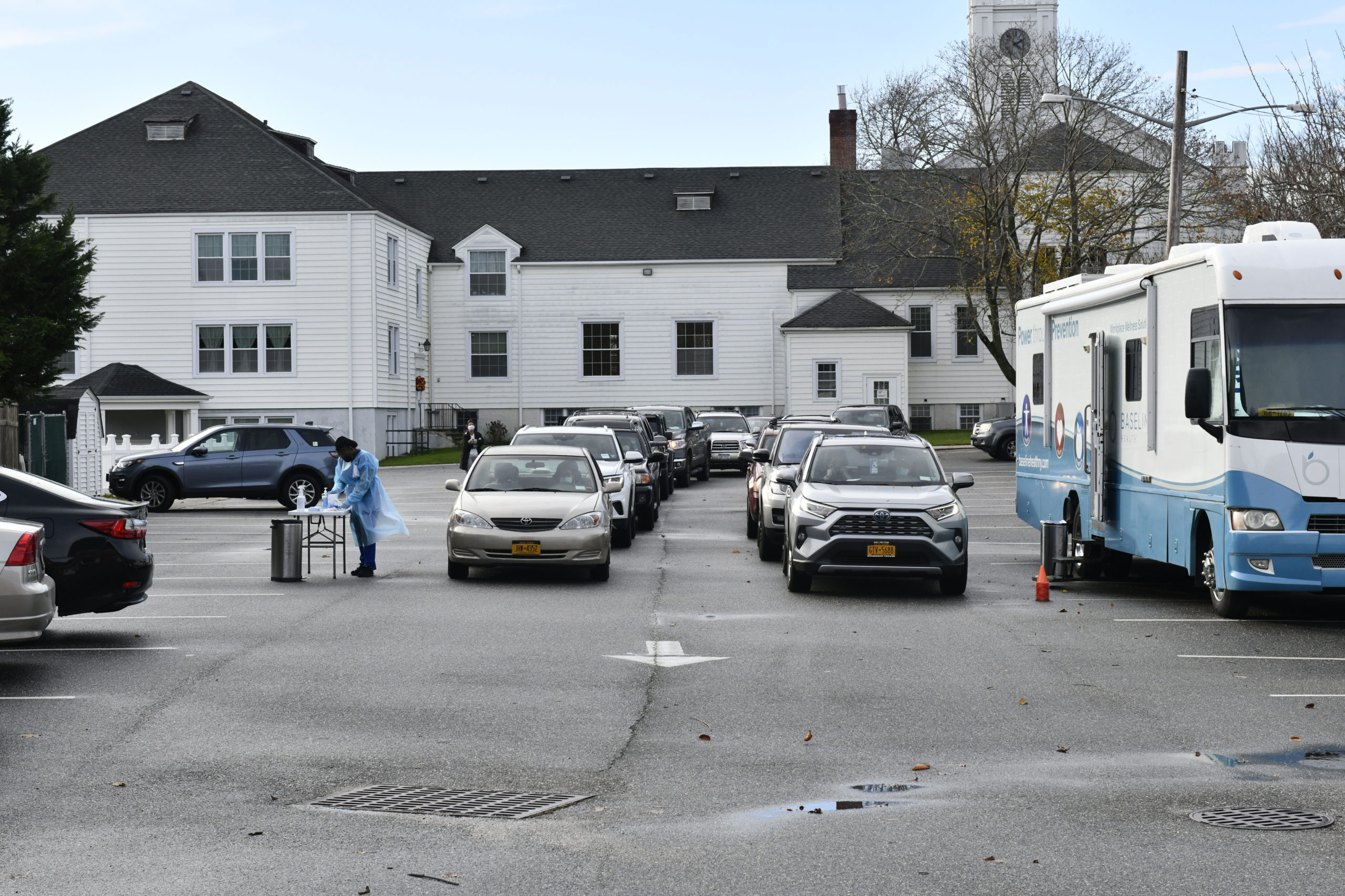 Cars line up for mobile COVID testing in the parking lot of the First Presbyterian Church in Southampton Village on Monday.      DANA SHAW