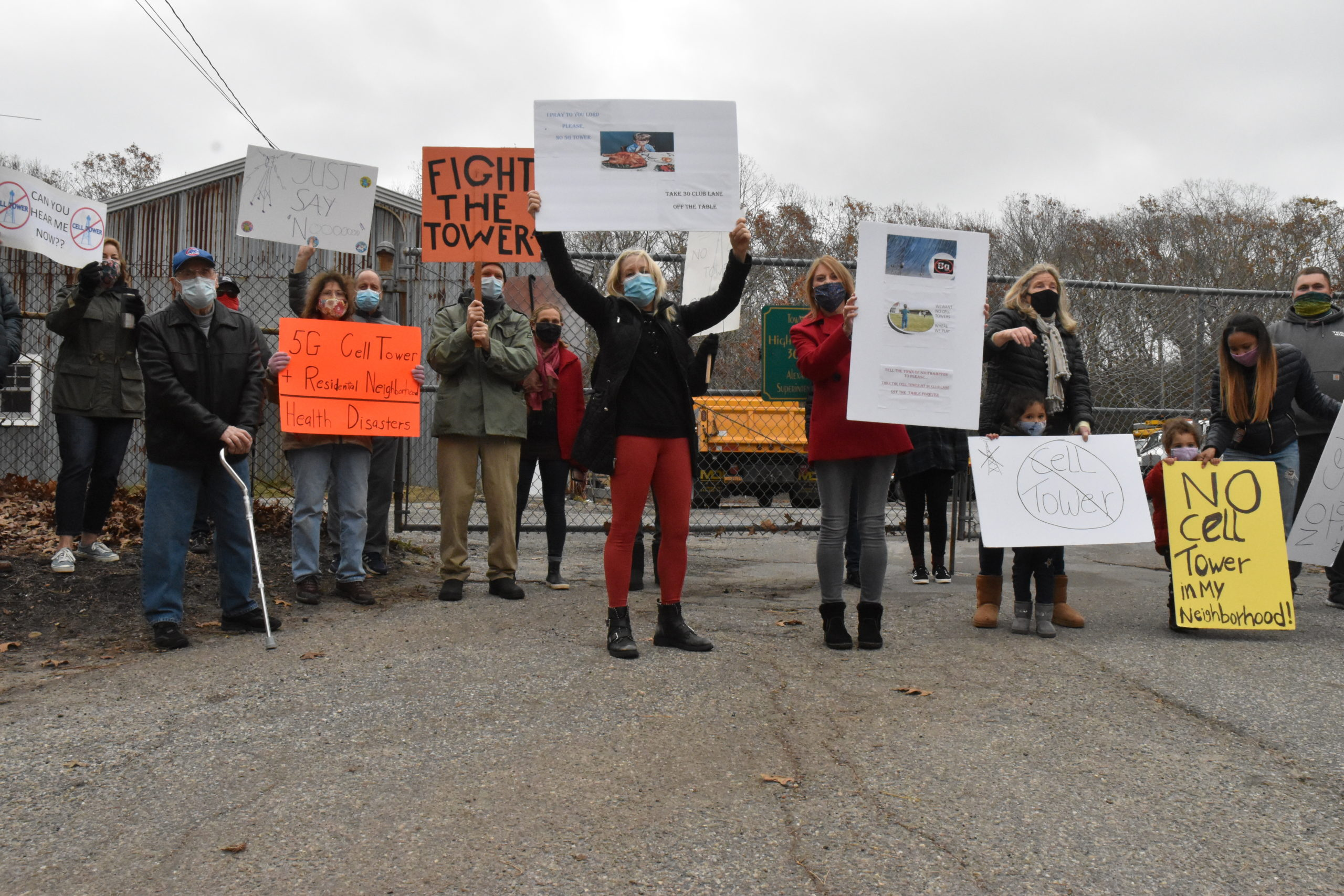 Noyac residents gathered Sunday to protest a proposal to build a cell tower at the Southampton Town Highway Department property at 30 Club Lane. STEPHEN J. KOTZ