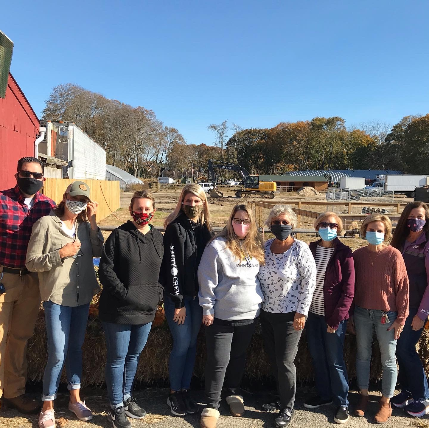 Micah Schlendorf, President of the Eastport Chamber of Commerce with members of the Eastport Green Project and the team from Olish Farms.