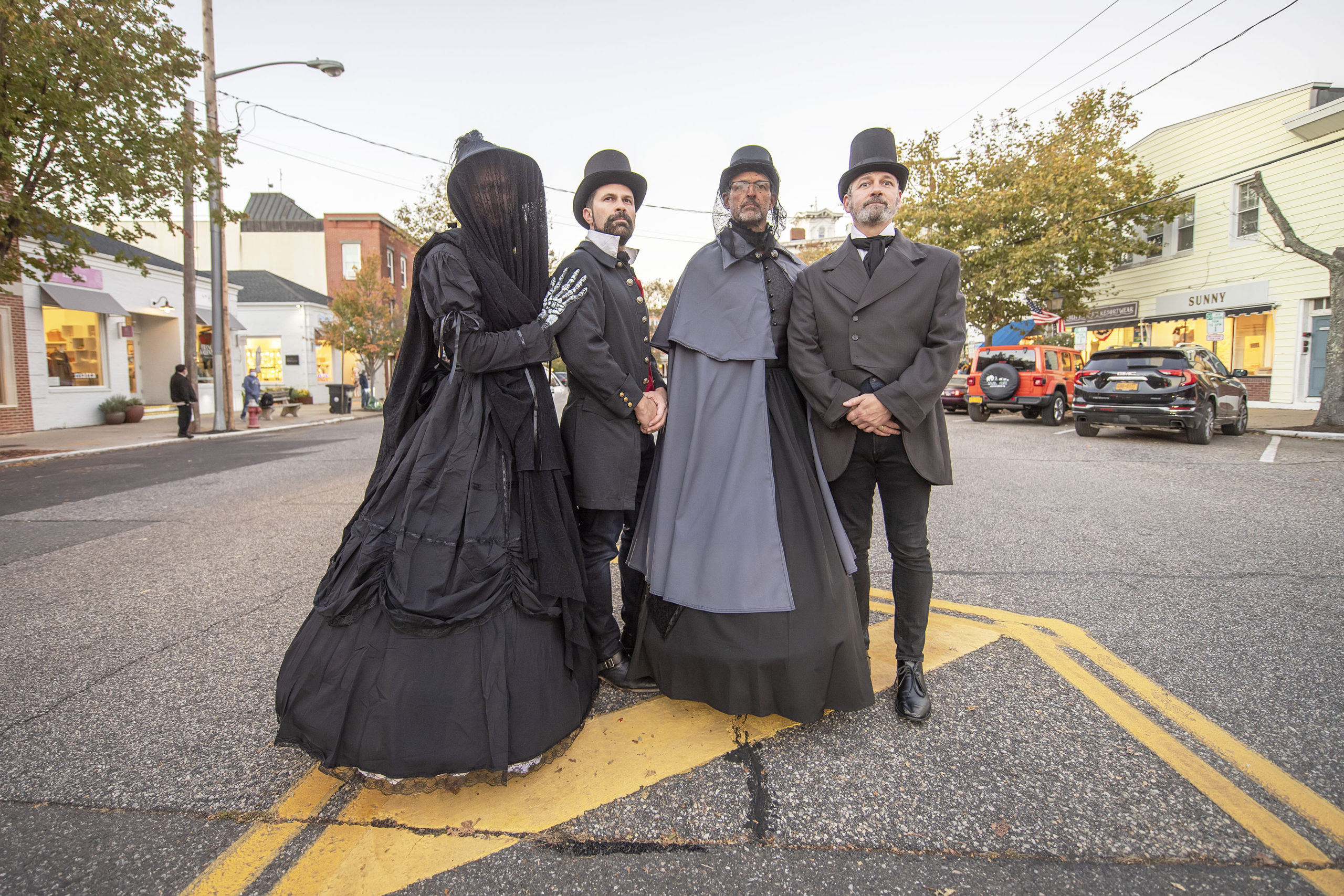 Butch Whitfield, Lindsay Denman, Mike Lambert and Jeremy Leffler made an elegant appearance on Main Street in Sag Harbor on Halloween afternoon.  MICHAEL HELLER