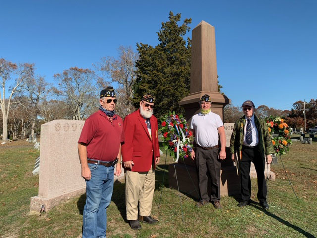 In observance of Veteran's Day, members of the Arthur Hamm Ellis American Legion Post #834 Westhampton  placed a wreath at the Westhampton Cemetery Veterans Memorial Stones on Sunday November 8. Left to right, Fred Bauer, Adjutant Paul Haines, Michael Berdinka, and Tom Mendenhall.