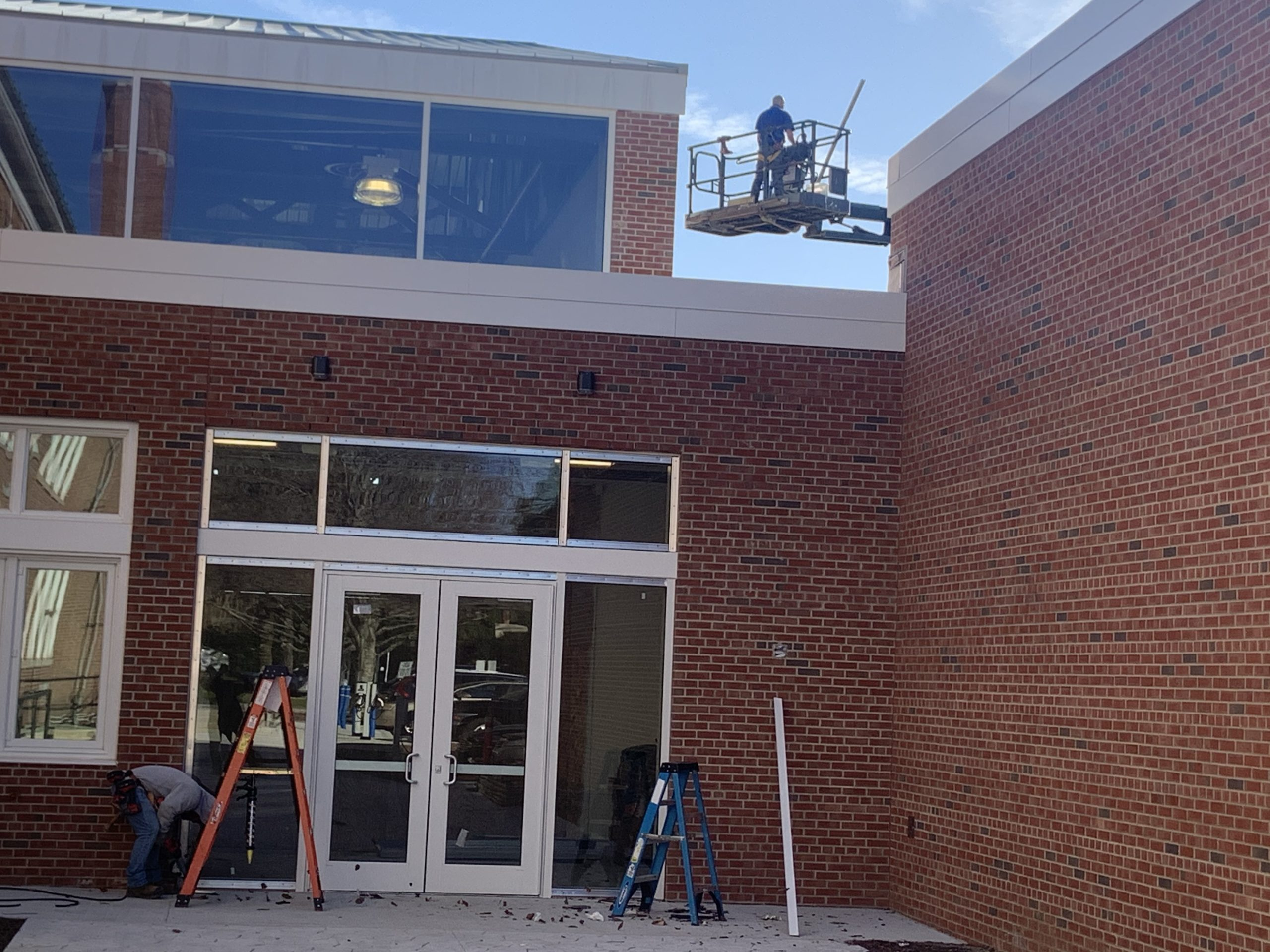 Contractors are working high and low on the final phases of the Bridgehampton School addition project. STEPHEN J. KOTZ
