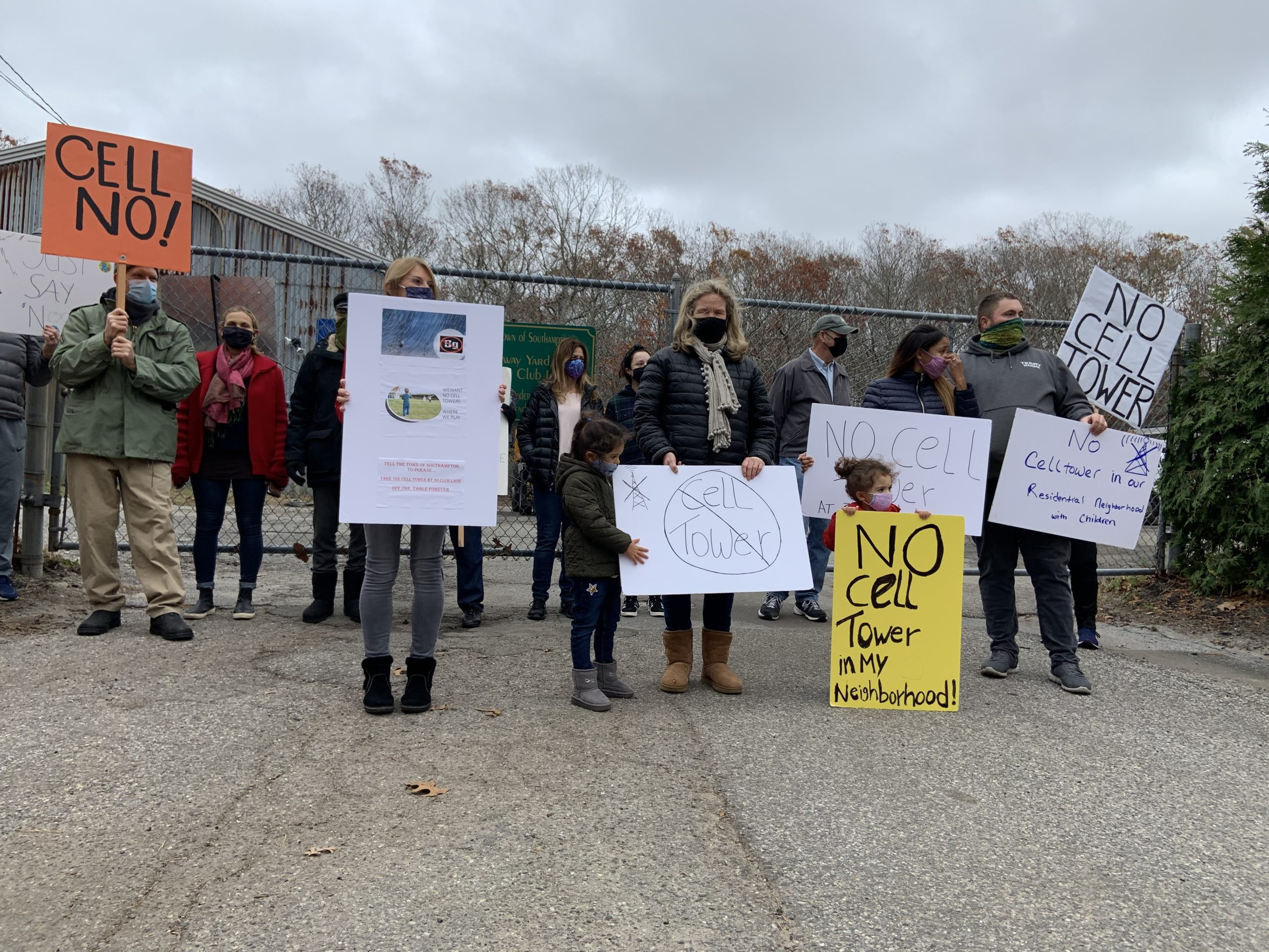 Neighbors gathered at a Southampton Town Highway Department depot at the end of Club Lane in Noyac to protest the possibility of the site being used for a cell tower. STEPHEN J. KOTZ