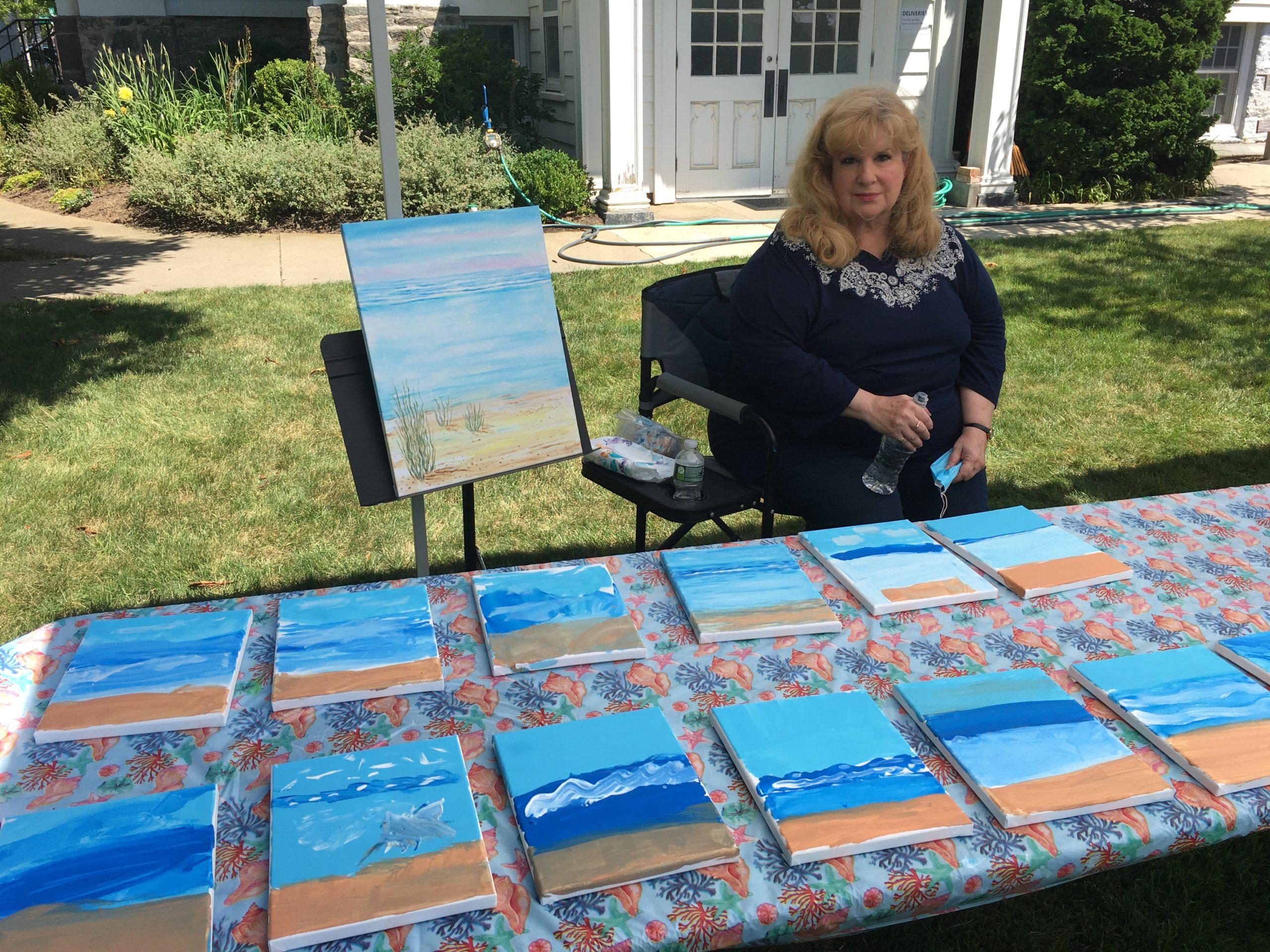 Katherine Mades displays her paintings.