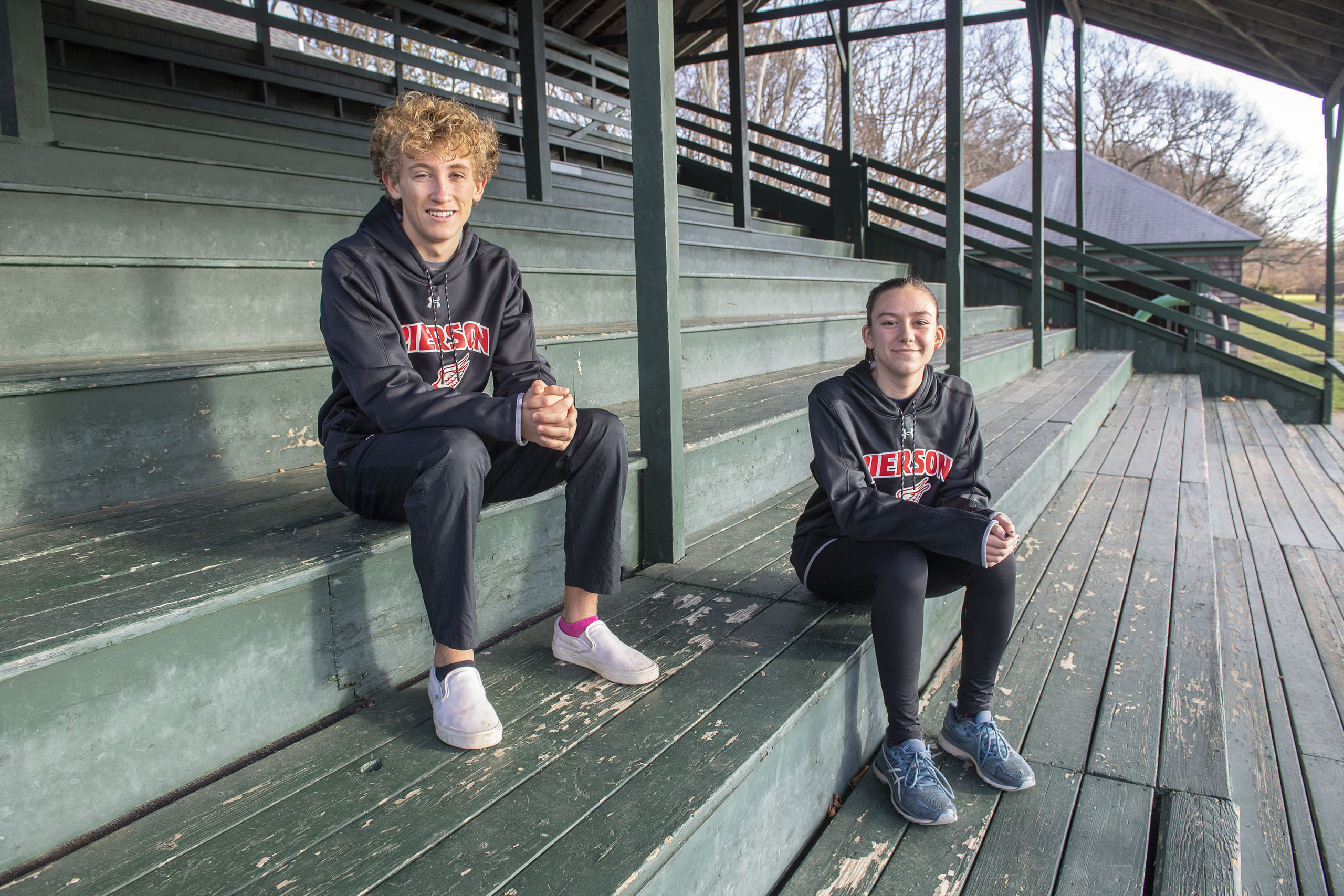 Pierson Cross Country runners Ben McErlean and Penelope Greene, photographed at Mashashimuet Park on Monday.    MICHAEL HELLER