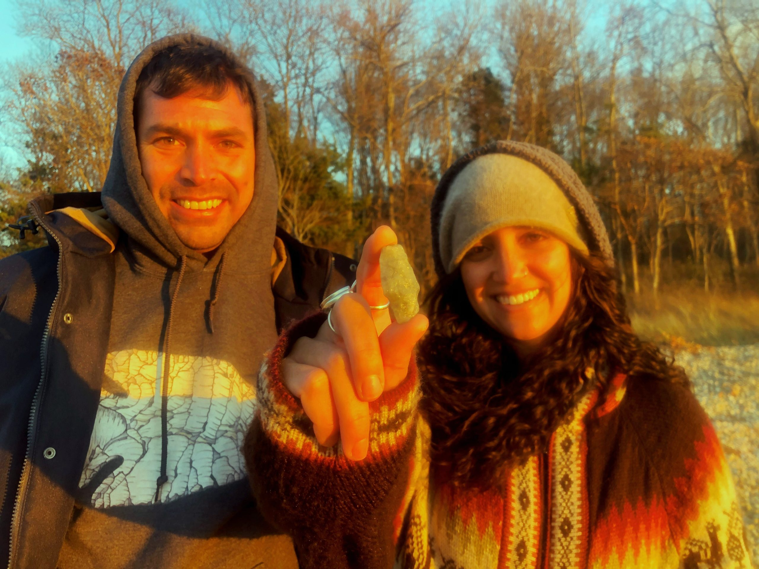 Laura Mayo shows off the ancient arrowhead she found on a local beach recently while hunting for artifacts with Orson Frisbee.