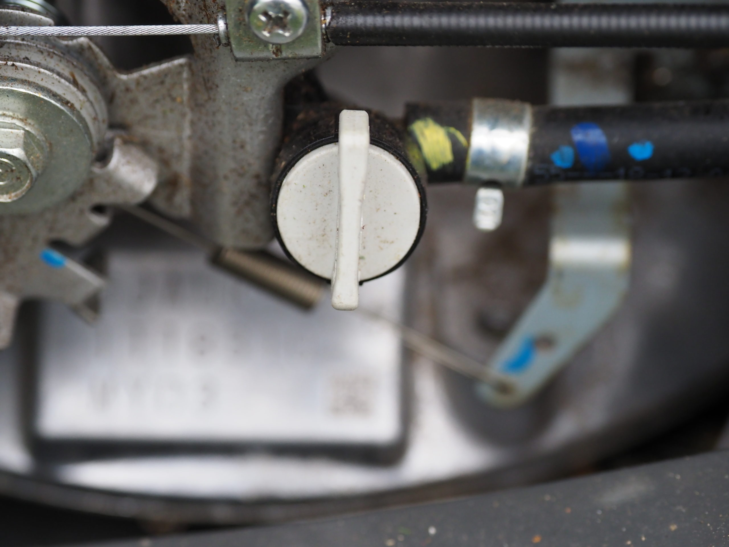 Only about the size of a quarter, this valve can save you a bundle. It's the fuel turn-off valve on a Honda lawn mower. In the vertical position it stops the fuel flow, thus burning off all the fuel in the engine so it can't do damage over the winter. The fuel in the tank is either emptied or treated and the valve left closed until spring start up.
