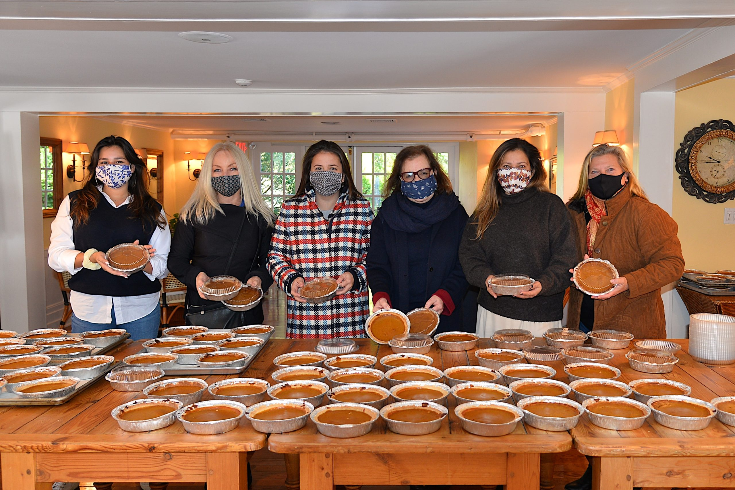 Hannah Rosario, Lisa Larsen, Jenny Lilja, Carol Hayes, Sandra Melendez and Trisha Erickson were part of the baking team that made and delivered 500 pumpkin pies to local food pantries to go with Thanksgiving dinners.