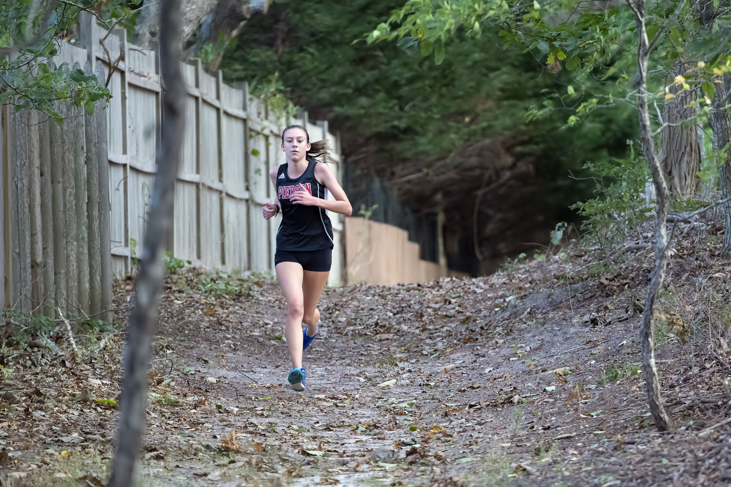 Pierson Cross Country Runner Penelope Greene competes against the Ross School at Mashashimuet Park on Monday afternoon.   MICHAEL HELLER