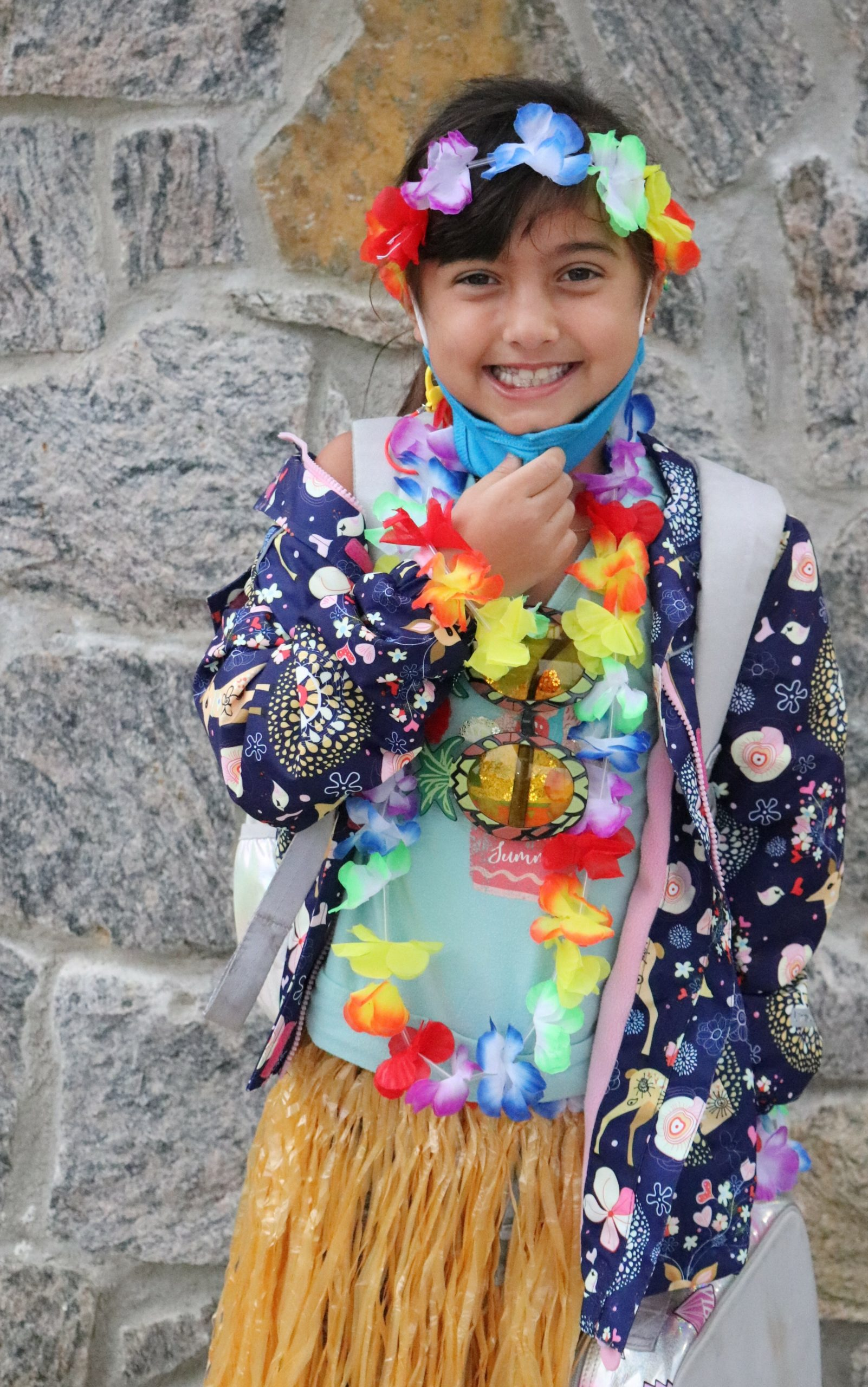 Second-grade student, Gianna Trimarco celebrates Hawaian Luau Day as part of Raynor Country Day School's Red Ribbon Week.
