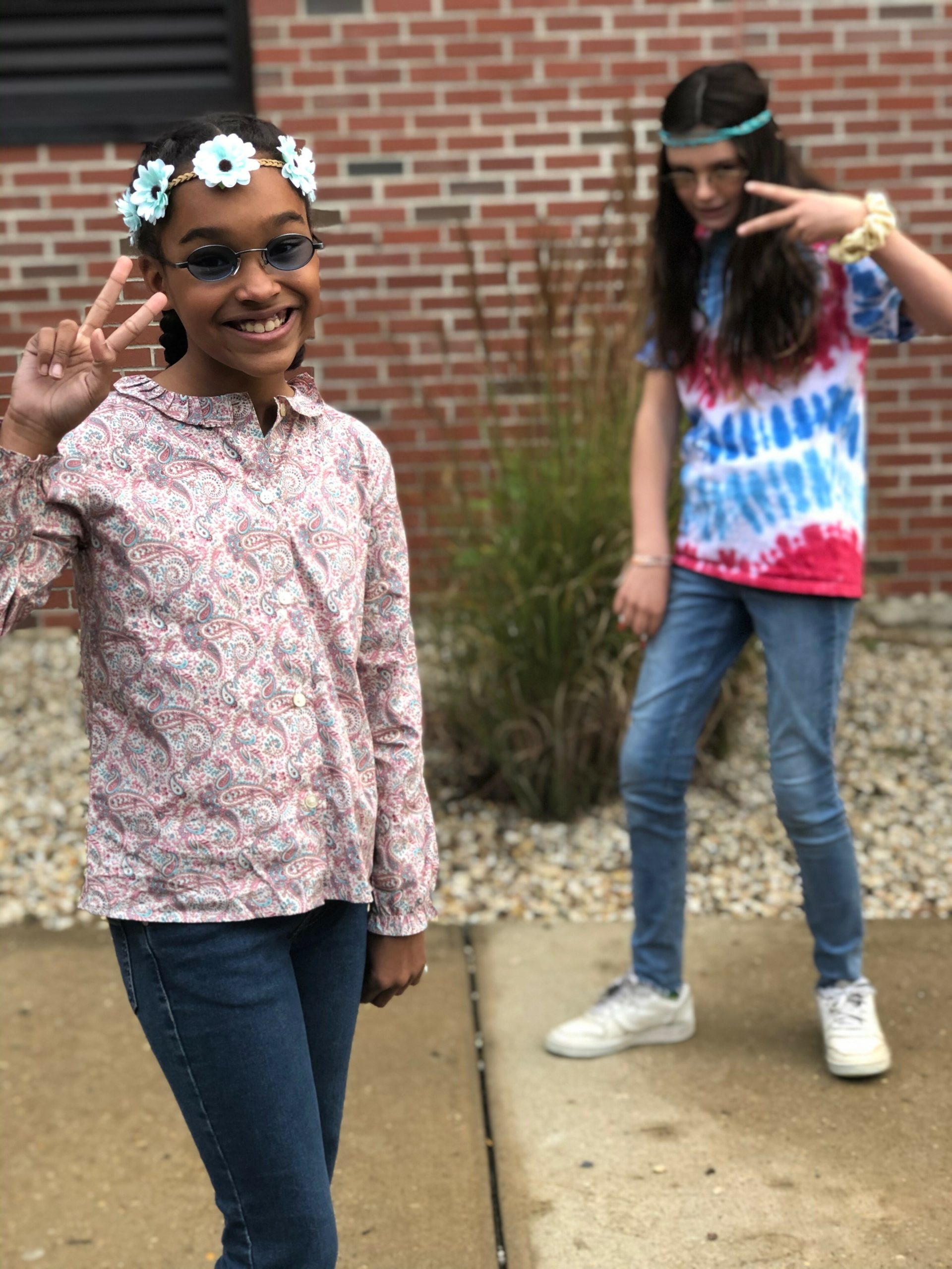 """Sixth graders Paige Francis and Wiley Reuss dressed in outfits from their favorite decade on """"Throwback Tuesday,"""" during Red Ribbon Week at Pierson Middle School."""