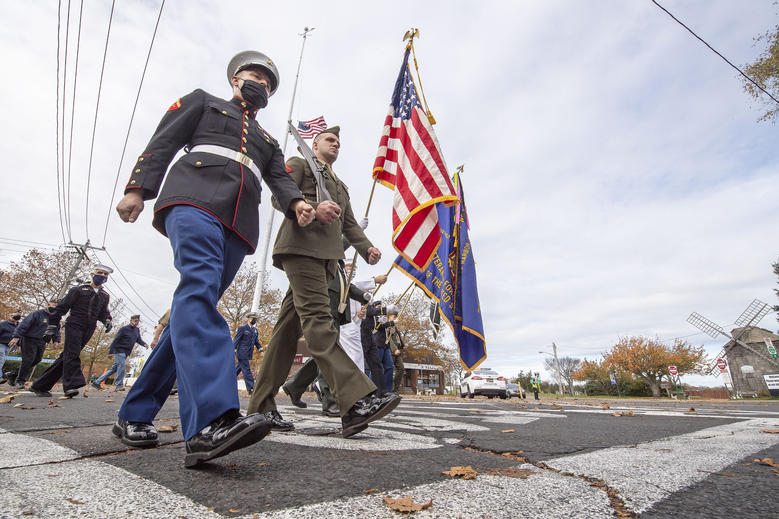 Sag Harbor veterans turn the corner onto Bay Street as they march in Sag Harbor on the morning of Veteran's Day.