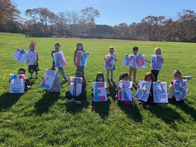 """After learning about the meaning of Veterans Day, Westhampton Beach Elementary School first graders worked together to create red, white and blue letters that spelled out """"Thank You Veterans."""""""