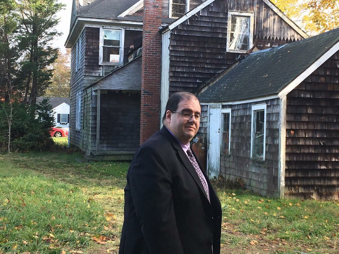 Southampton Town Public Safety Administrator Ryan Murphy  touring a zombie house in Eastport. KITTY MERRILL