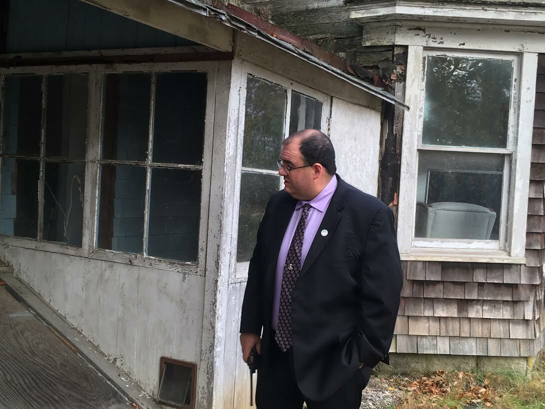 Southampton Town Public Safety Administrator Ryan Murphy made note of multiple access points for animals in the Eastport zombie house. KITTY MERRILL