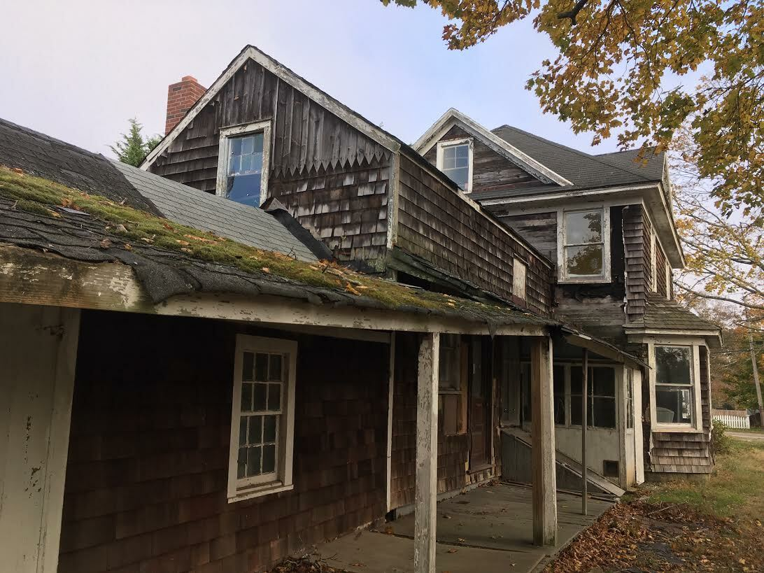 There are an estimated 300 houses in foreclosure in the Town of Southampton, 100 of them vacant and deteriorating like this one in Eastport. KITTY MERRILL