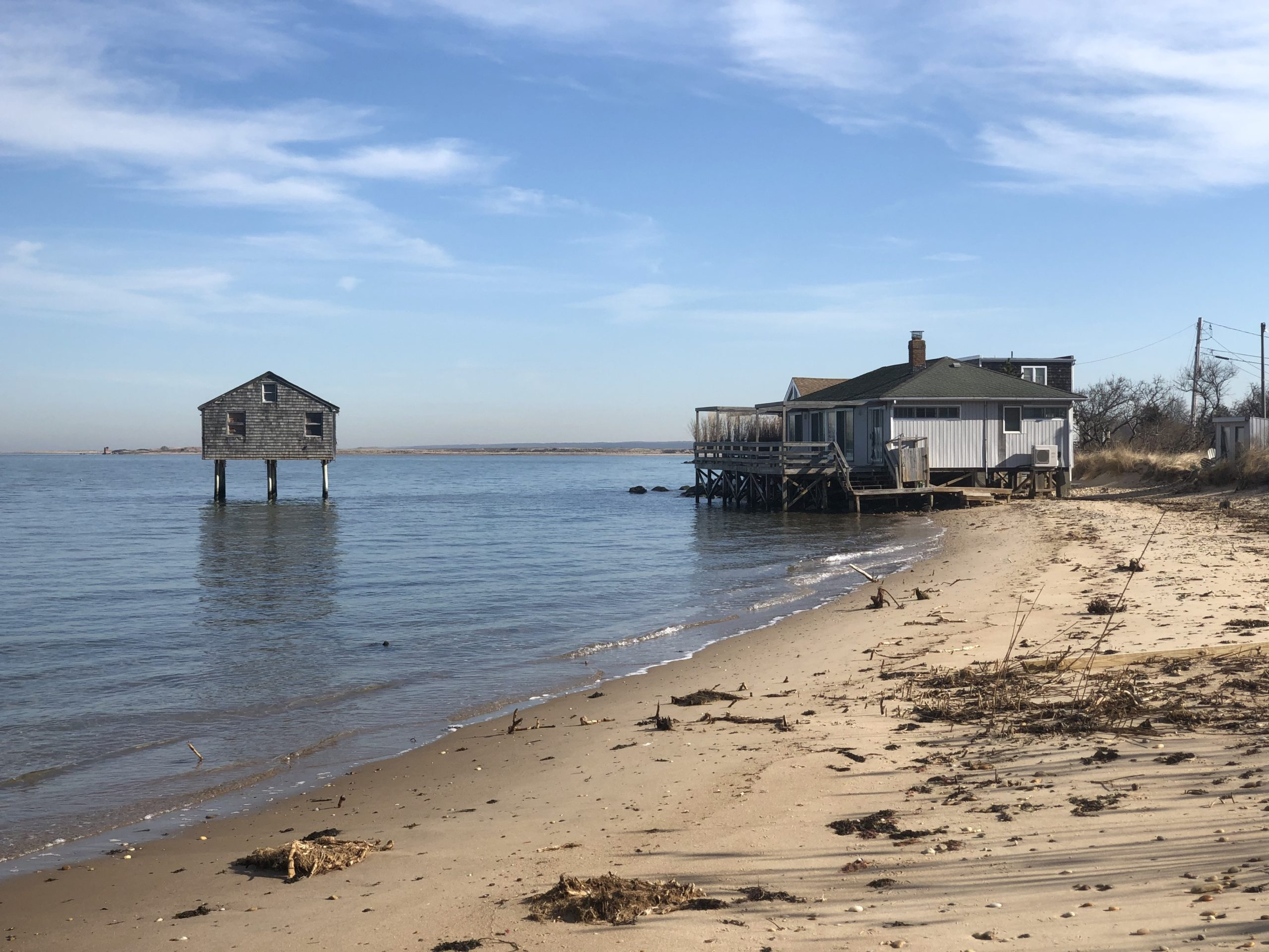 The waters of Gardiners Bay have steadily shoved the shoreline near Lazy Point inland, to the point that the homes at the very end of Mulford Lane have gone from inland to waterfront. The town zoning board denied an application by a Mulford Lane homeowner to construct a stone revetment.