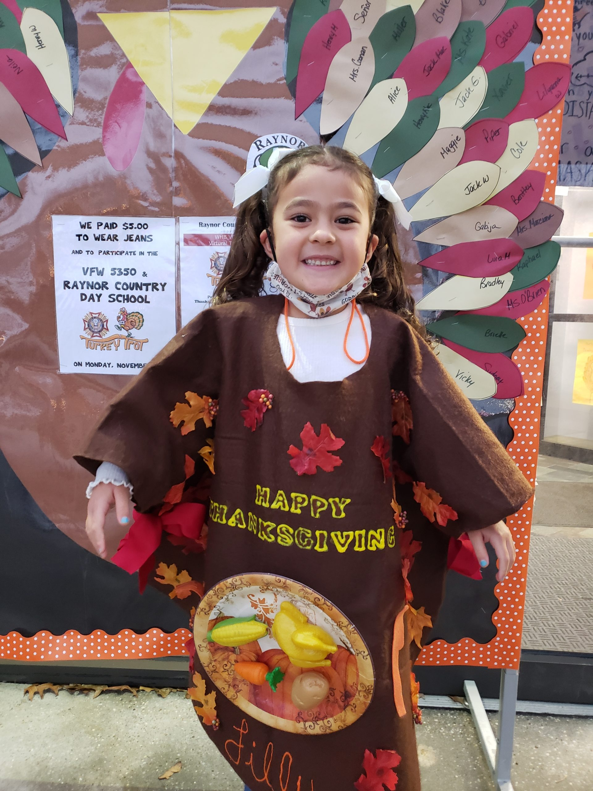 Kindergarten student, Lily Benjamin, takes a moment to pose before heading into the Raynor Country Day School VFW Turkey Trot.