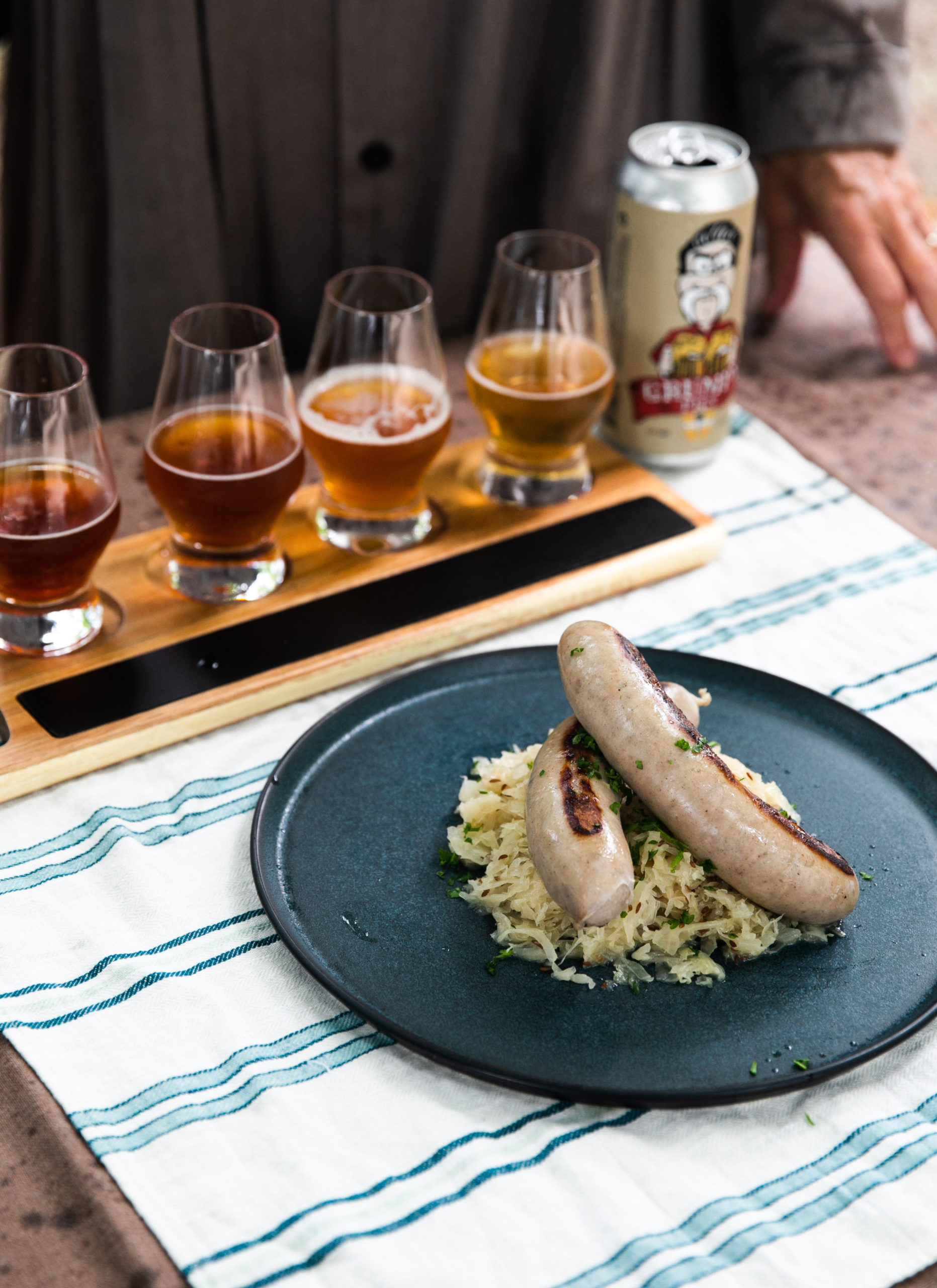 Bangers with beer braised sauerkraut is one of the recipes in the February book from the Loaves & Fishes Farm Series.