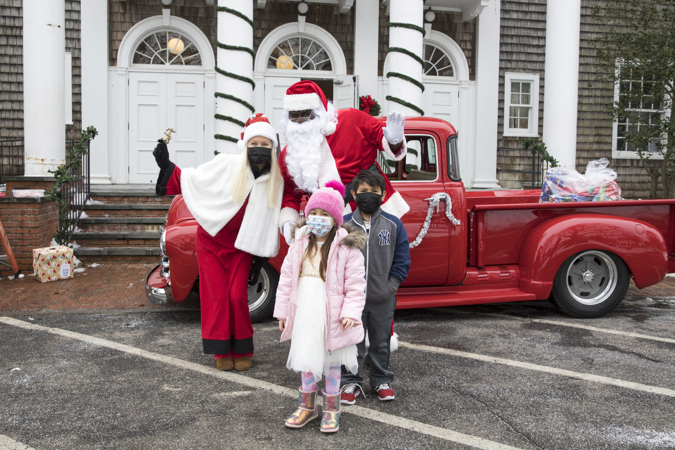 Hampton's Community Outreach Organization holds a toy drive at the Bridgehampton Community Center on Sunday, December 21, with Sofia Lopez 6, and Justin Lopez, 7, stopping by to meet Santa.