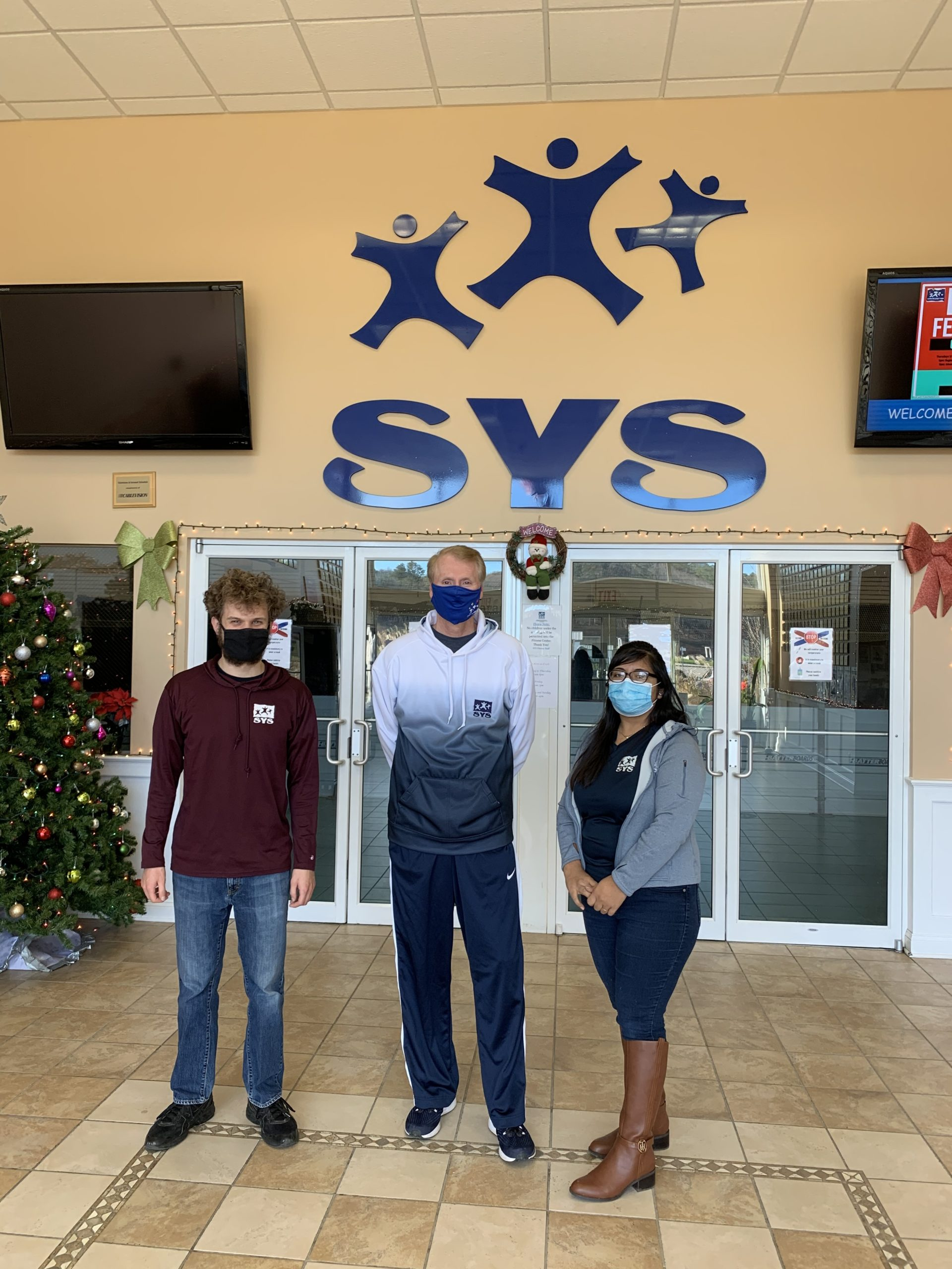 Evan Gravano, Scott Johnson, and Amairani Hernandez, staff members at Southampton Youth Services worked together to help save the life of a man who collapsed while playing pickle ball at the recreational center on November 30.