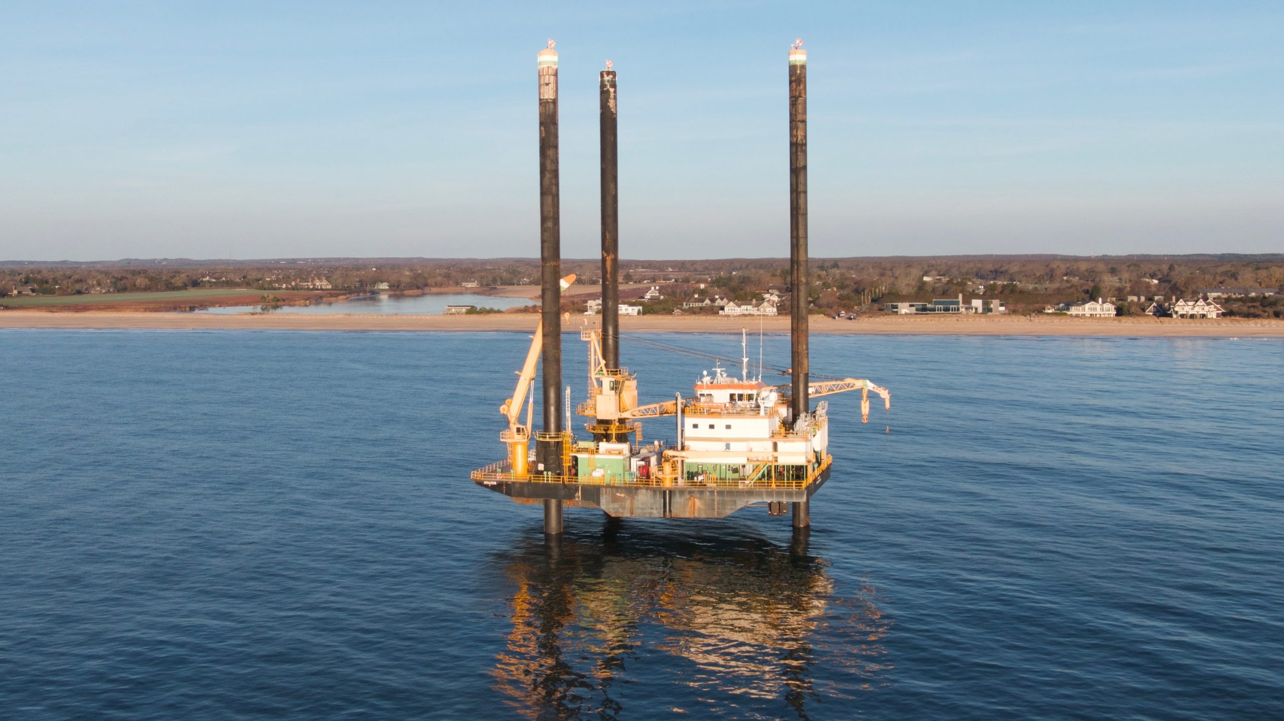 The barge, which can jack itself above the ocean's waves is being used to conduct survey drilling of the seafloor off Wainscott as part of the preparations for the installation of the South Fork Wind Farm power cable.