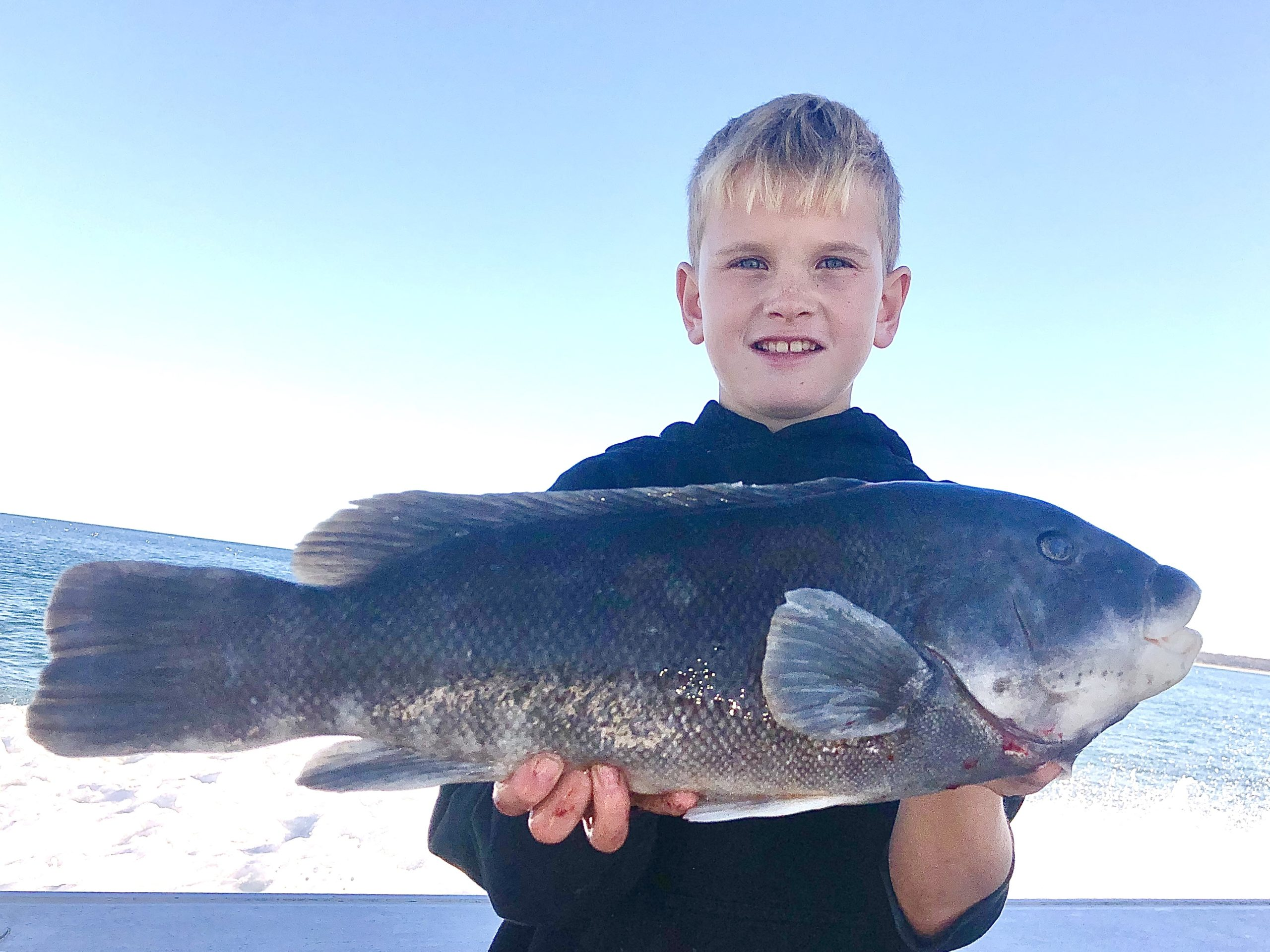 Matty Dettleff with a big Fishers Island blackfish caught aboard the Flying Dutchman.
