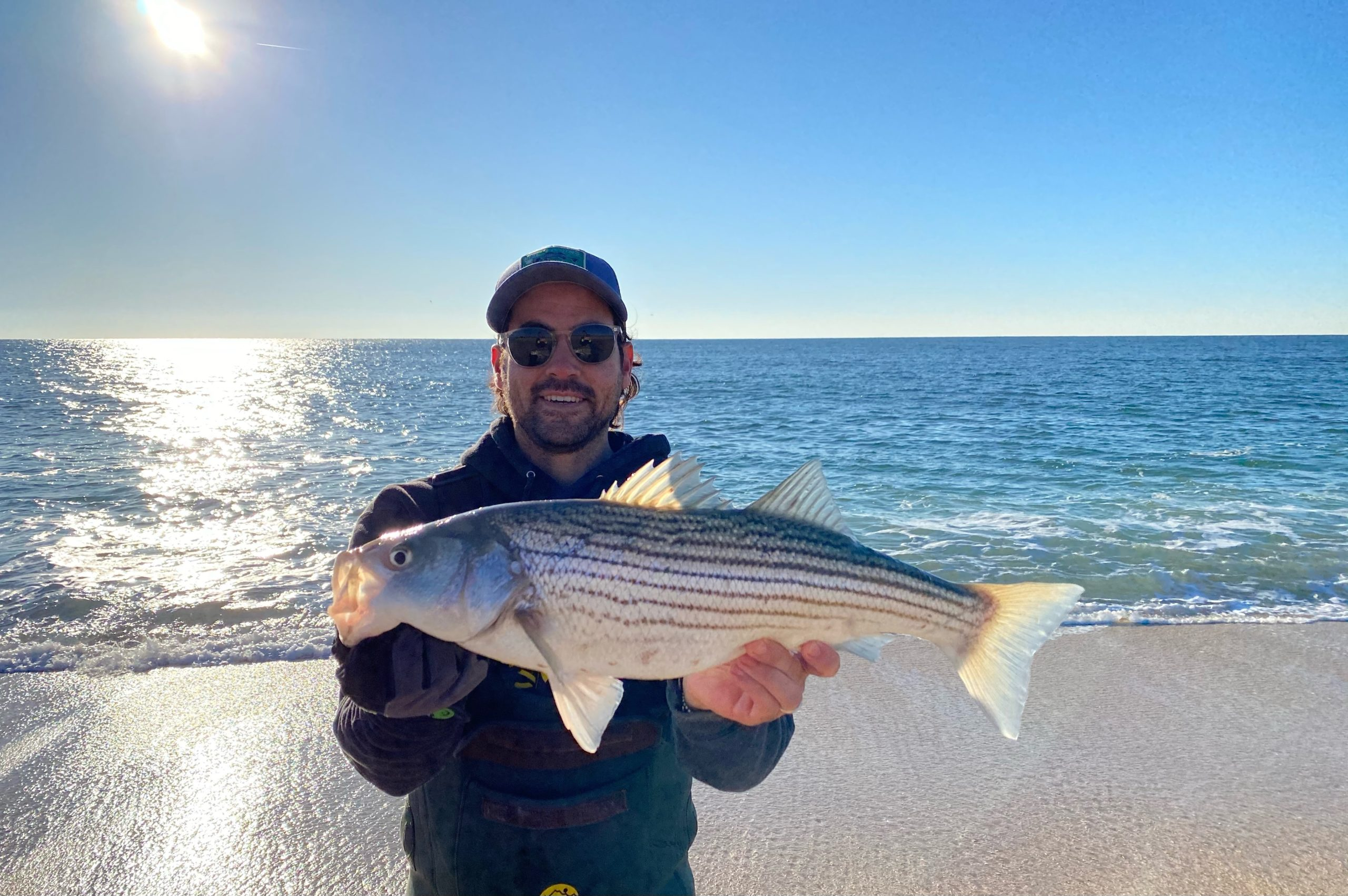 Steve Lobosco with one of the final migrators from the 2020 striped bass run.