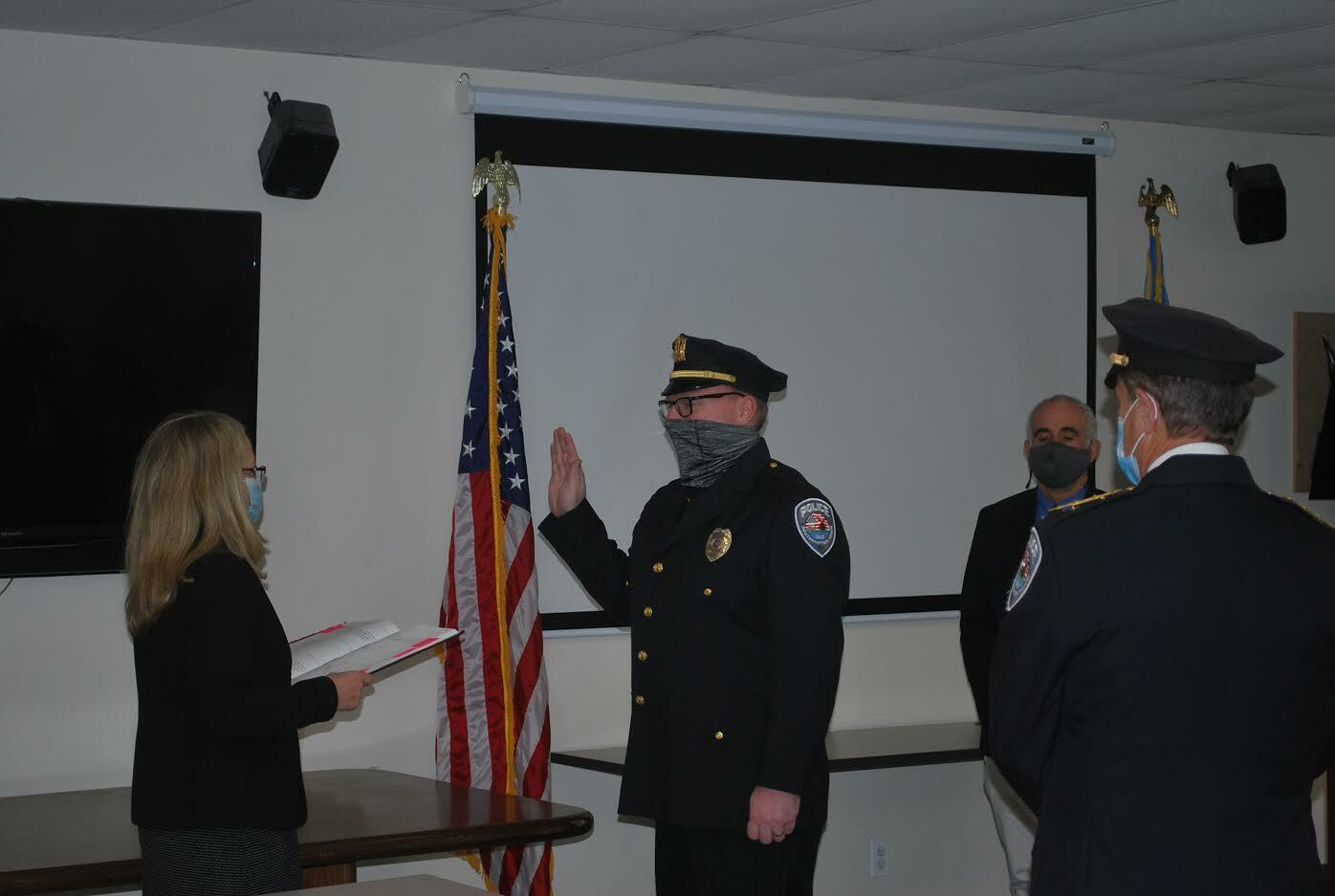 Town Clerk Sundy Schermeyer swears in Howard Kalb, promoting the sergeant to the rank of lieutenant in the Southampton Town Police Department. COURTESY STPD