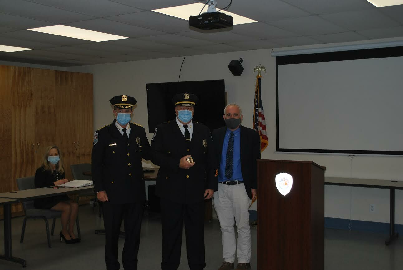 James Kiernan was promoted to captain on November 24. With him are Southampton Town Police Chief Steven Skrynecki and Southampton Town Supervisor Jay Schneiderman. COURTESY STPD