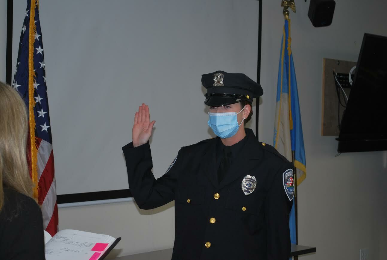 Shannon Merker takes the oath of office, becoming one of the newest members of the Southampton Town Police Department. COURTESY STPD.