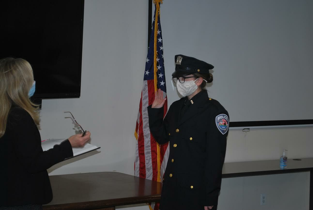 Madeline Sgange takes the oath of office, becoming one of the newest members of the Southampton Town Police Department. COURTESY STPD